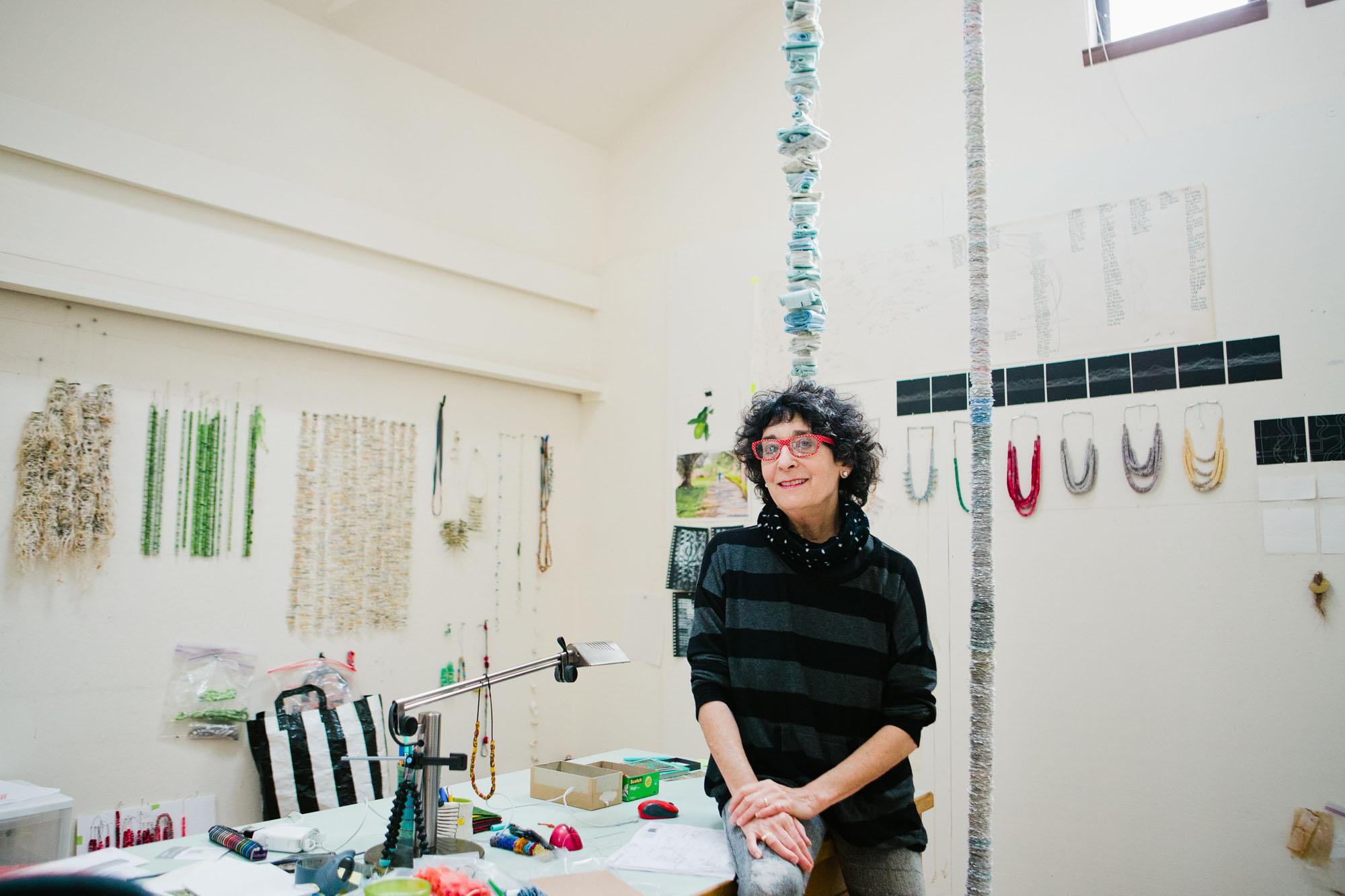 female_artist_in_art_studio-daniella-worlfe-branding.jpg
