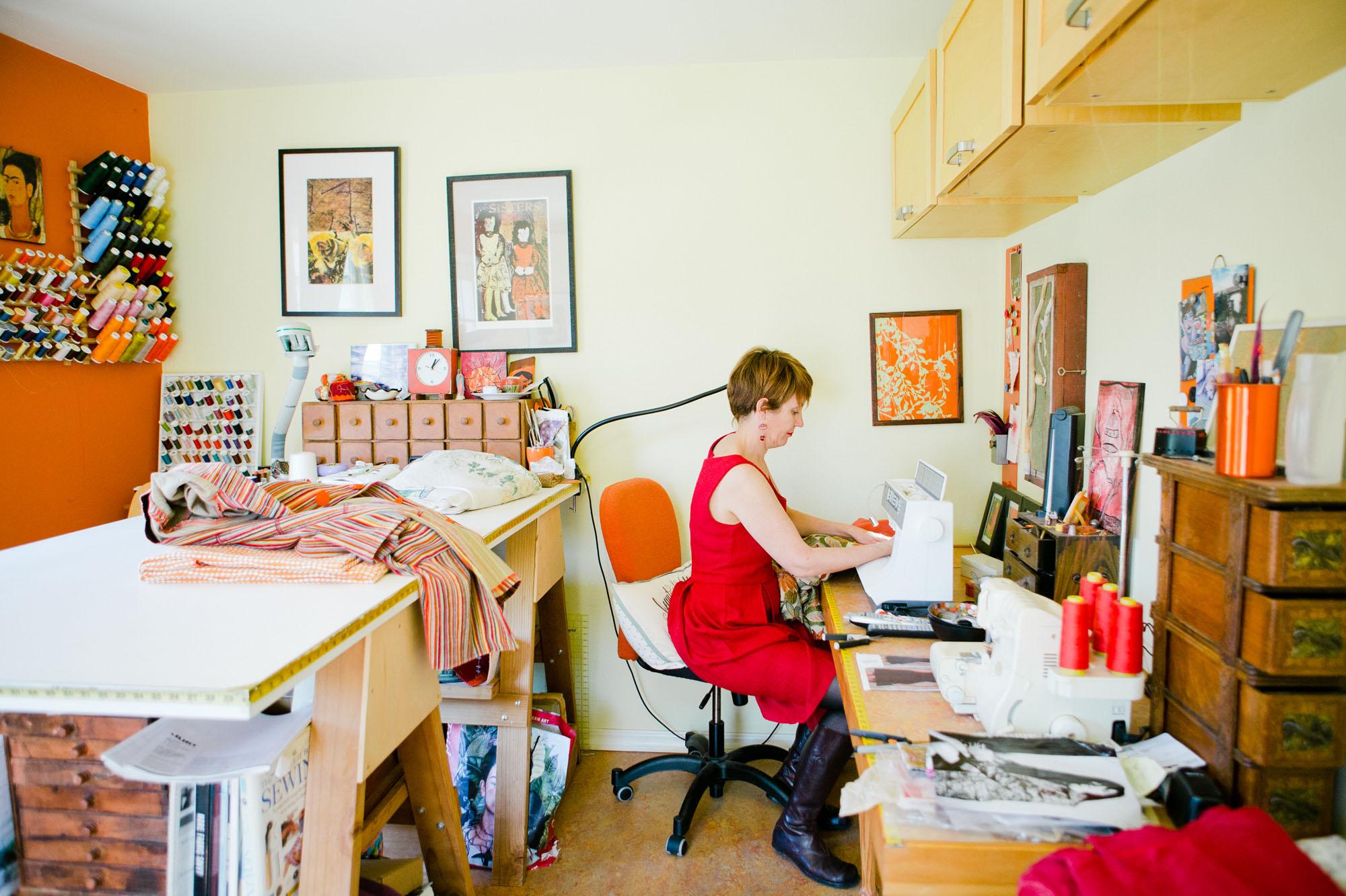 woman_in_artist_studio_sowing_fabric.jpg