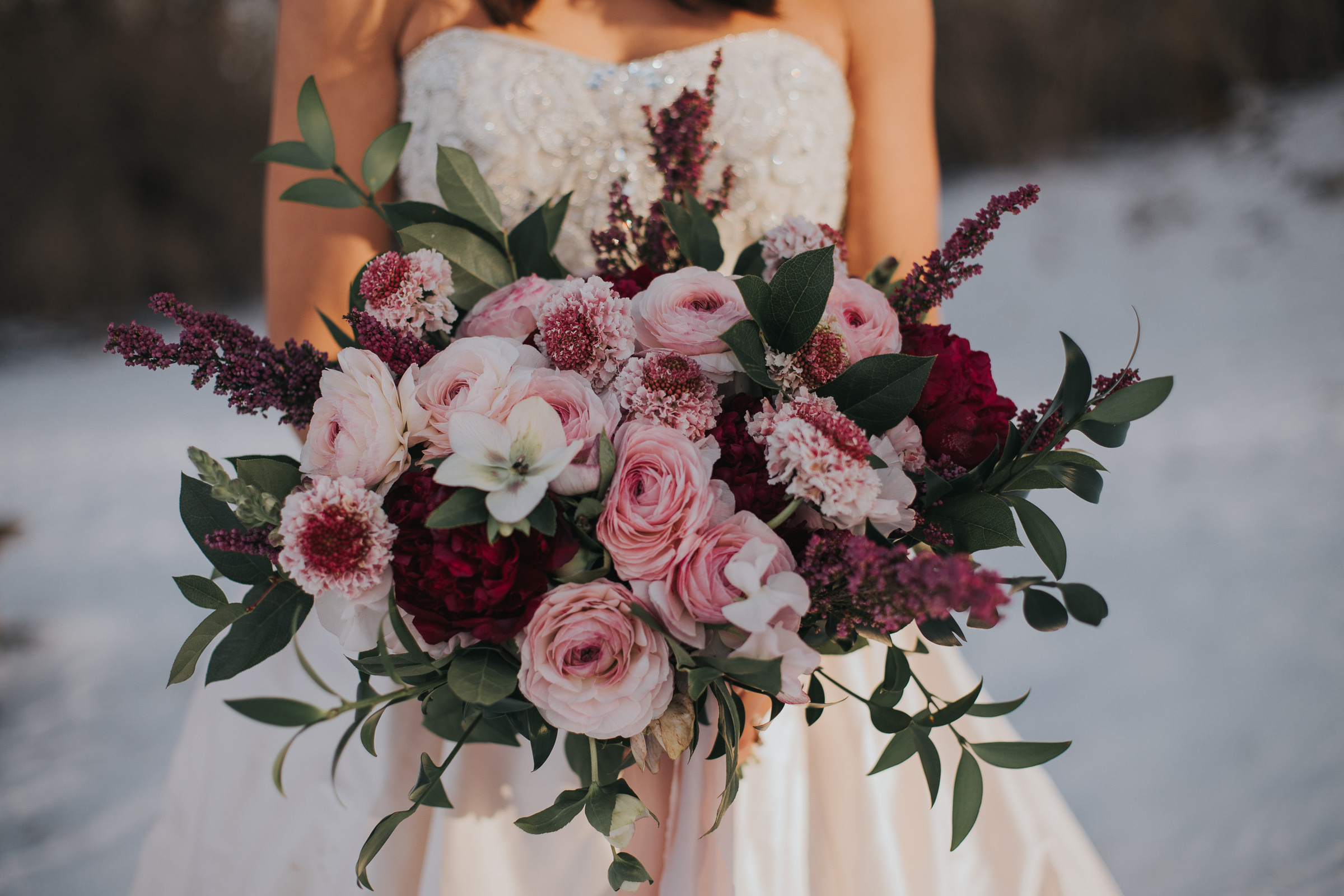 Organic garden bouquet  Style: romantic, wispy Details: Clooney ranunculus, hellebore, scabiosa, burgundy peonies, heather, ruscus, salal   {Photo courtesy of    Morgan Barrett   }
