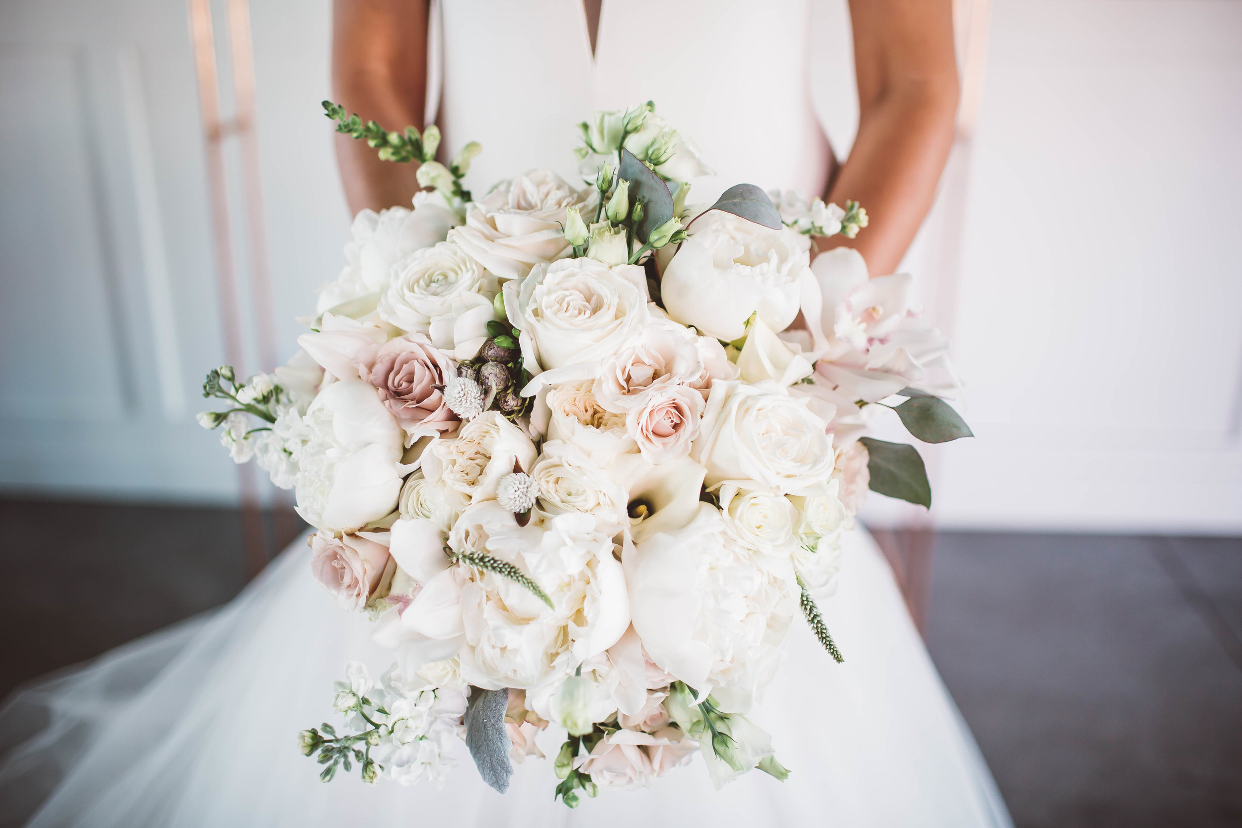 Round Bouquet with Slight Cascade  Style: elegant, minimal greenery  Details: peonies, orchids, lisianthus, quicksand roses, veronica, garden roses, minimal eucalyptus greenery   {Photo courtesy of    Atley + Liz Collective   }