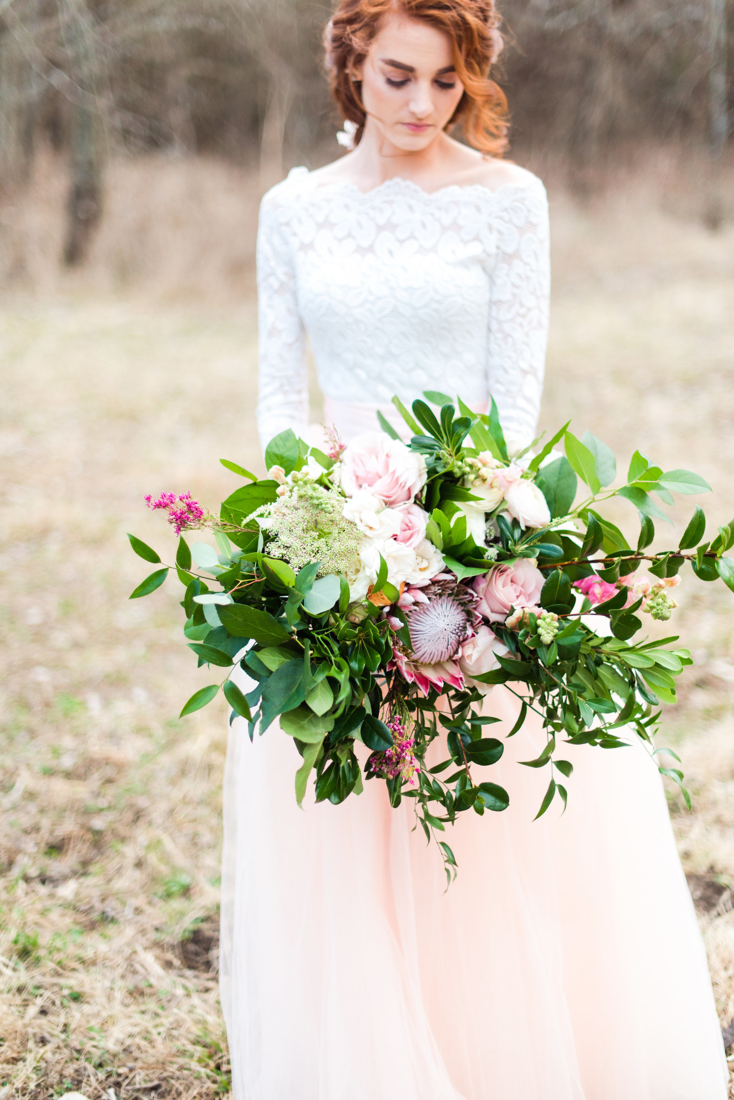 Large Wild Greenery-Focused Bouquet  Style: boho, woodland, organic Details: large king protea, full greenery, textures   {Photo courtesy of    Lacey Rene Studios   }