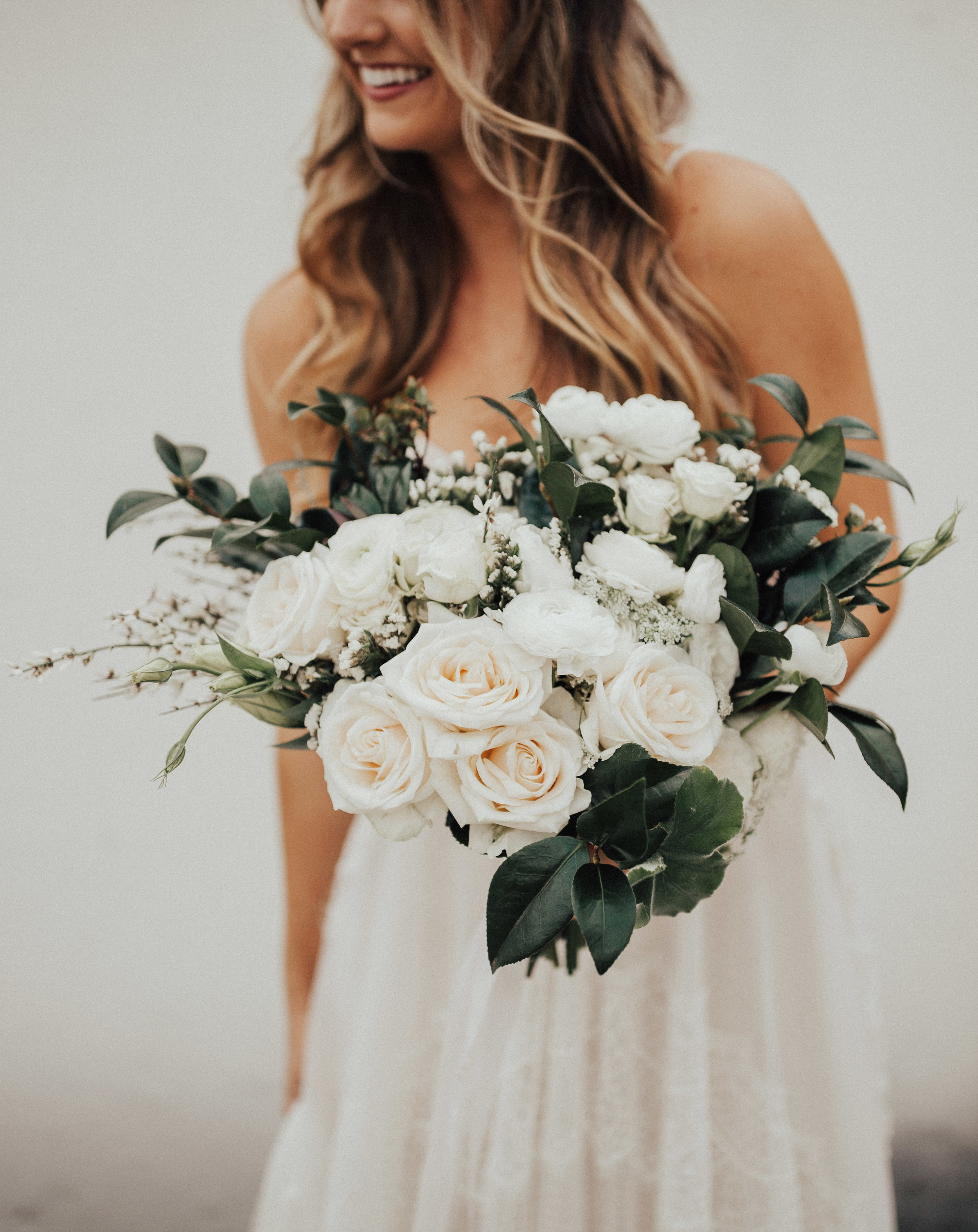 Medium Round Garden Bouquet  Style: textured Details: roses, raunuculus, greenery   {Photo courtesy of    Christy Johnson   }