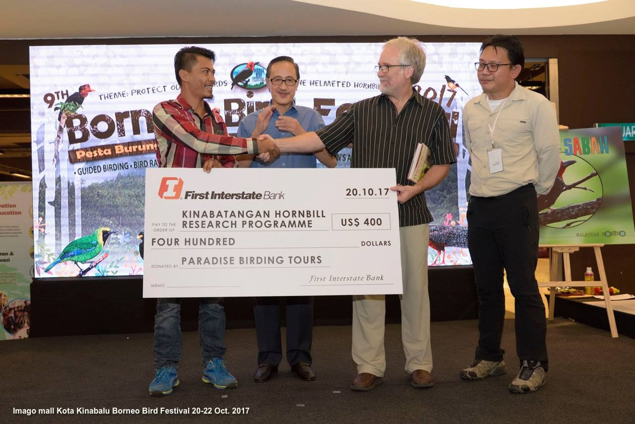 Steve Shunk presents a donation at the Borneo Bird Festival