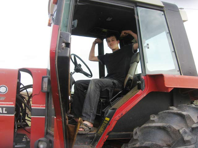 "A farm Son's first solo on the ""big"" tractor!"