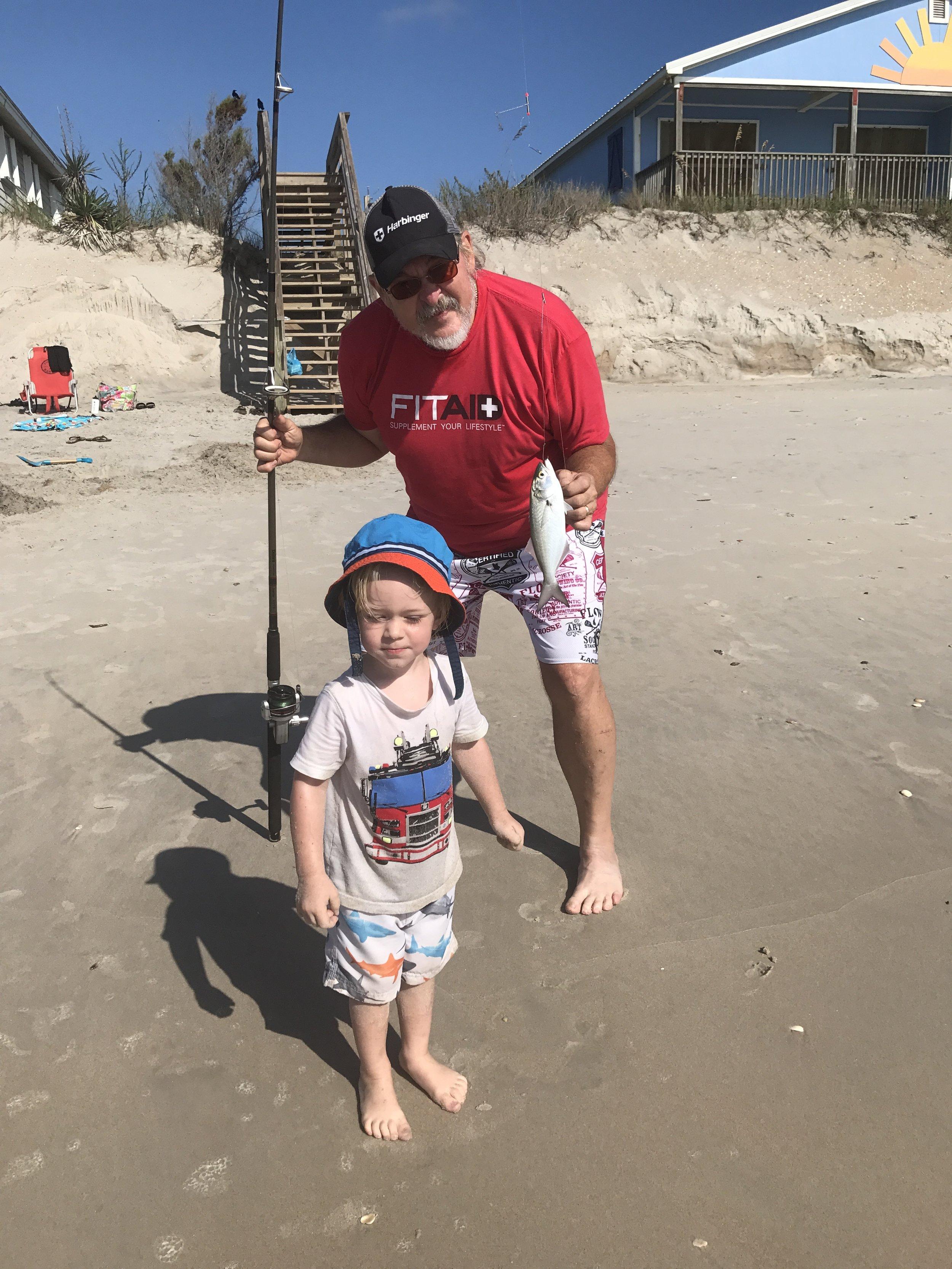 poppy and rock at beach.JPG