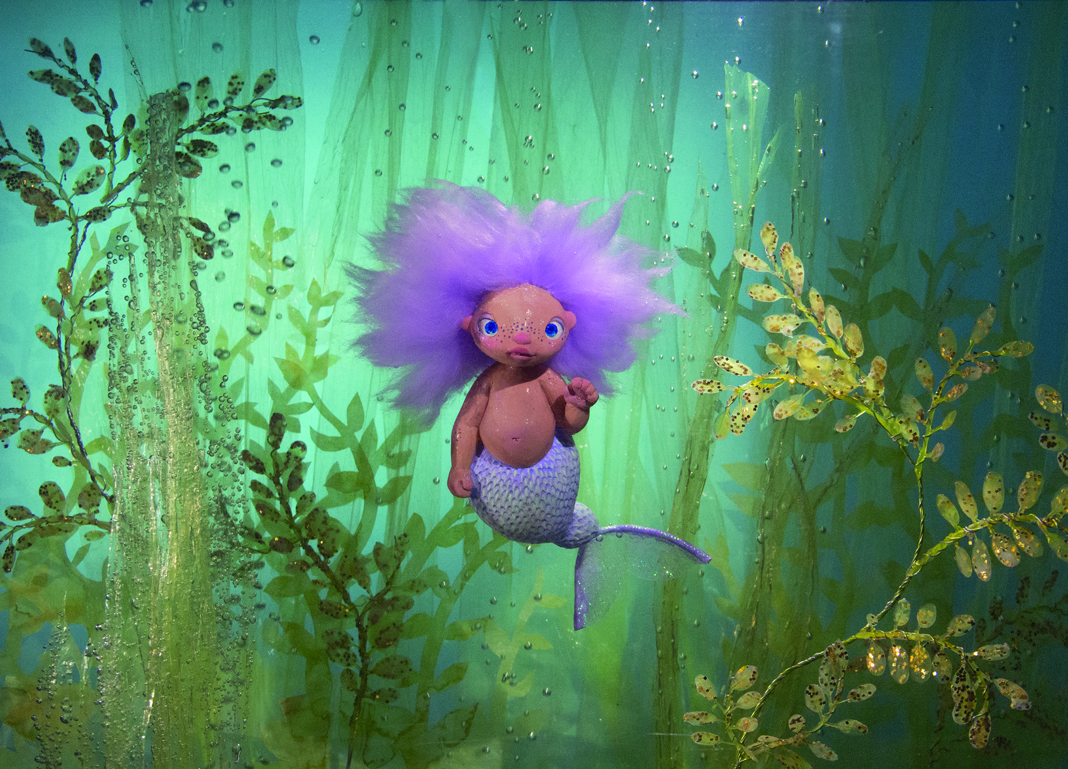 A little merbaby sculpture photographed underwater for a children's book idea I've been working on.