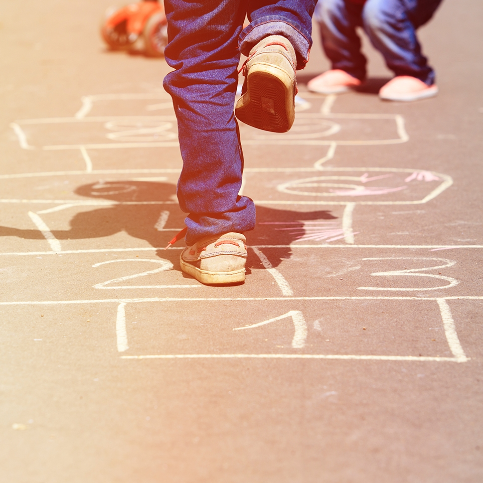 stock-photo-kids-playing-hopscotch-on-playground-outdoors-370414346.jpg