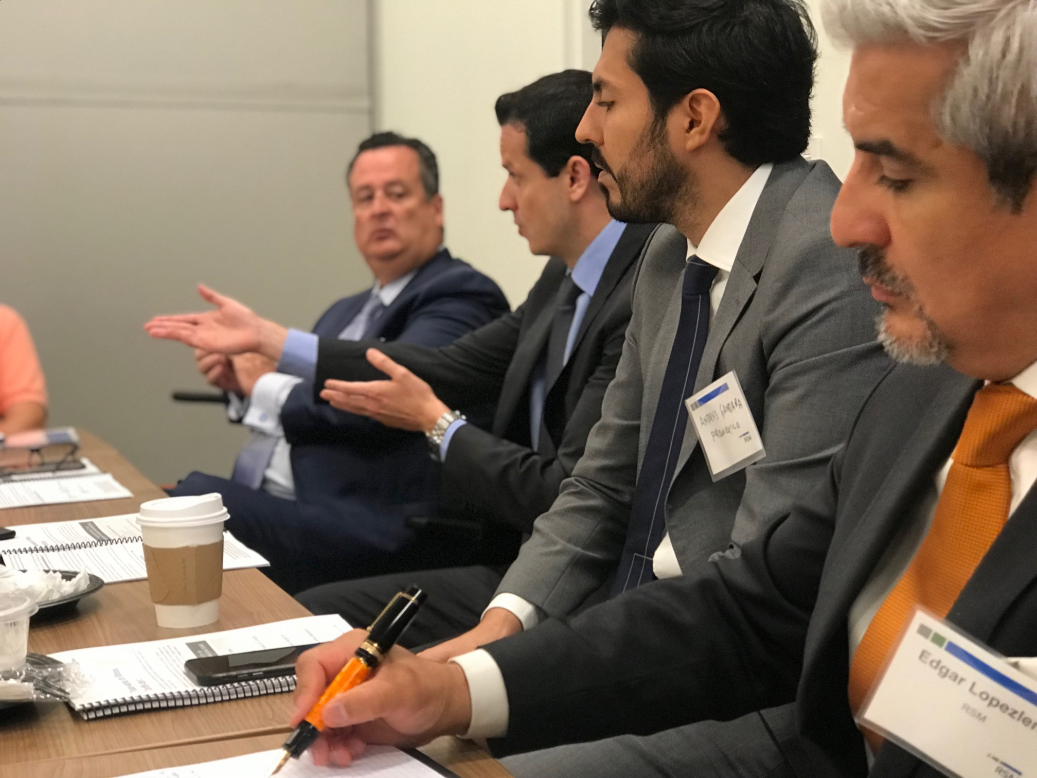 Martin Caro (Center), ProMexico Trade Commissioner in Chicago, briefs the audience on the results of the recent elections in Mexico