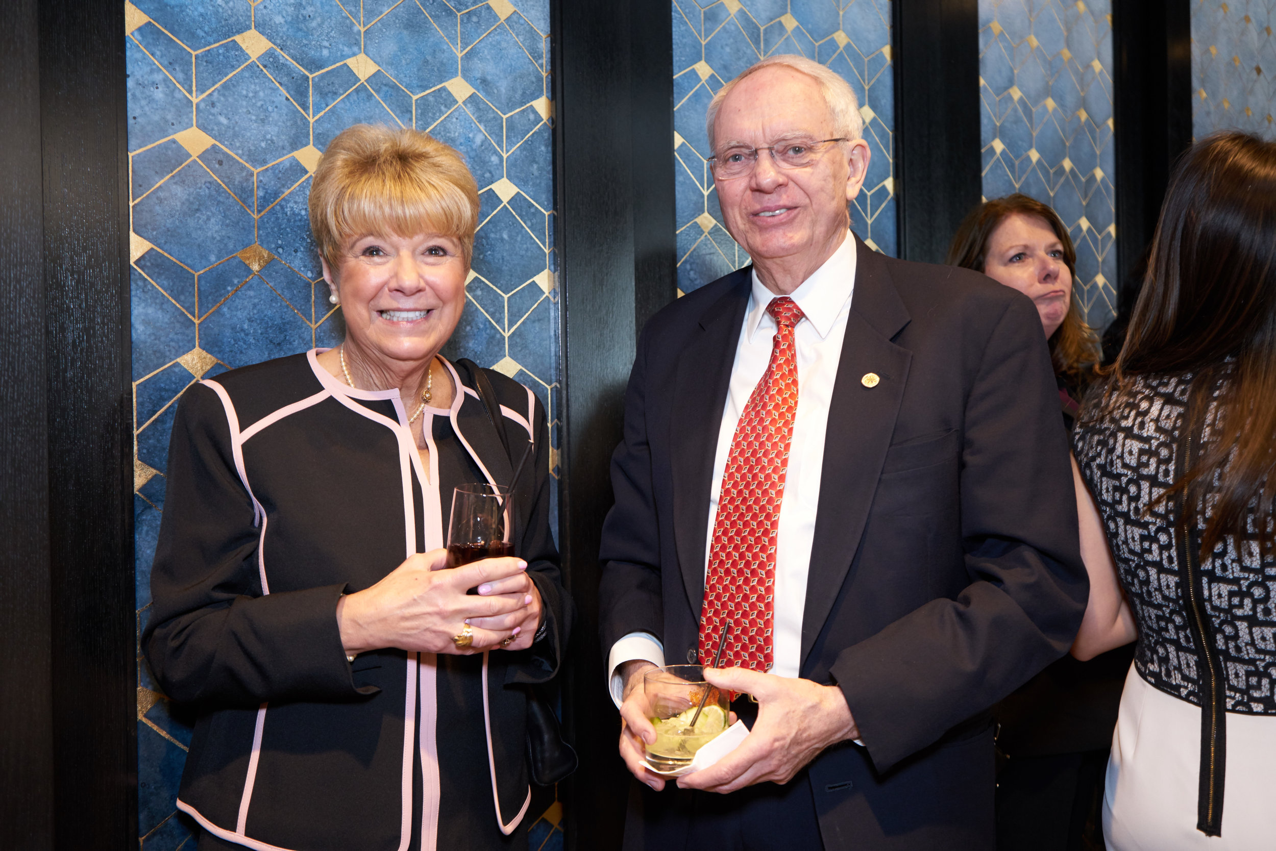 Maureen Biedermann with John  McLees of Baker McKenzie