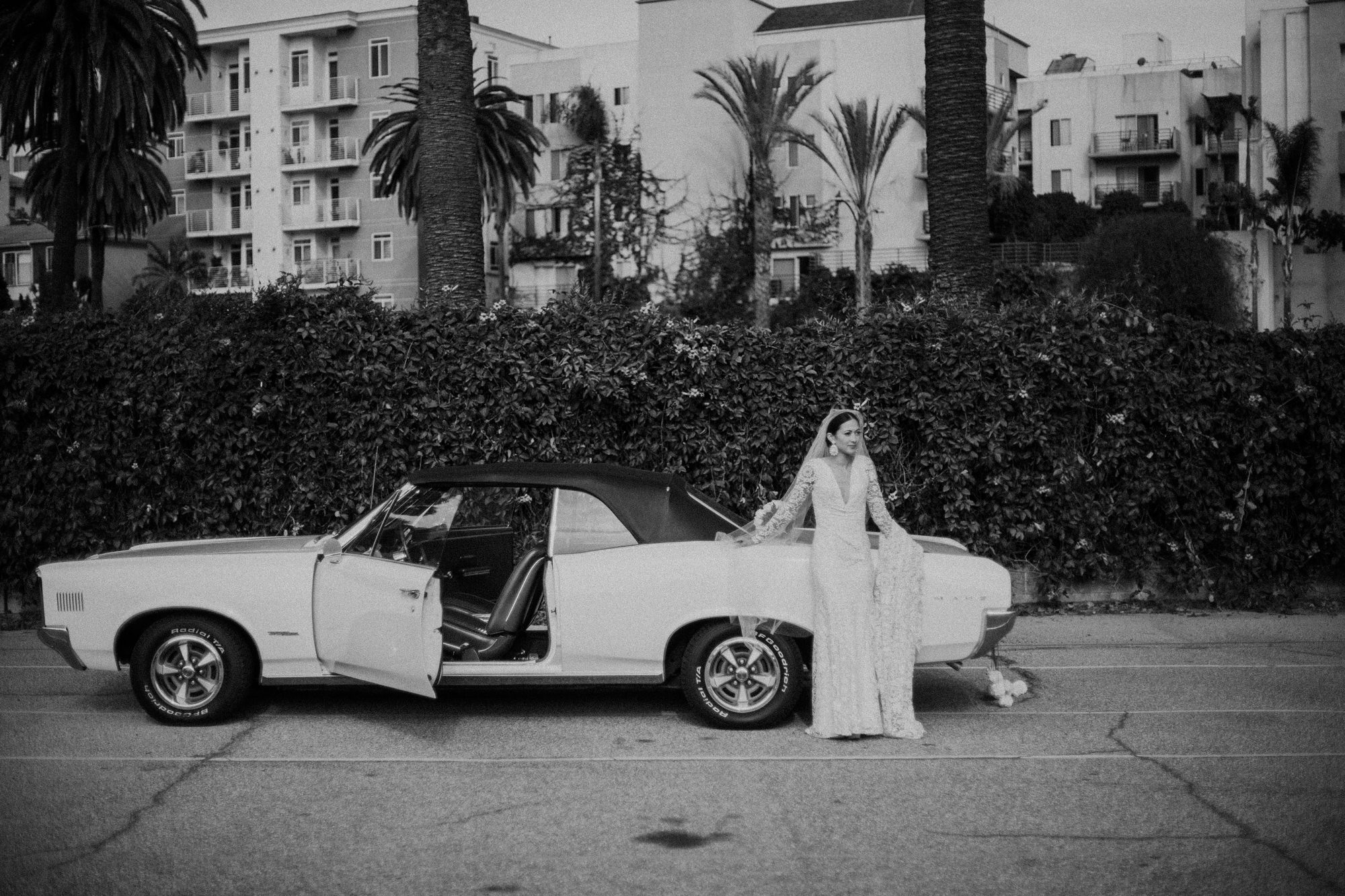 bride waiting next to her white car