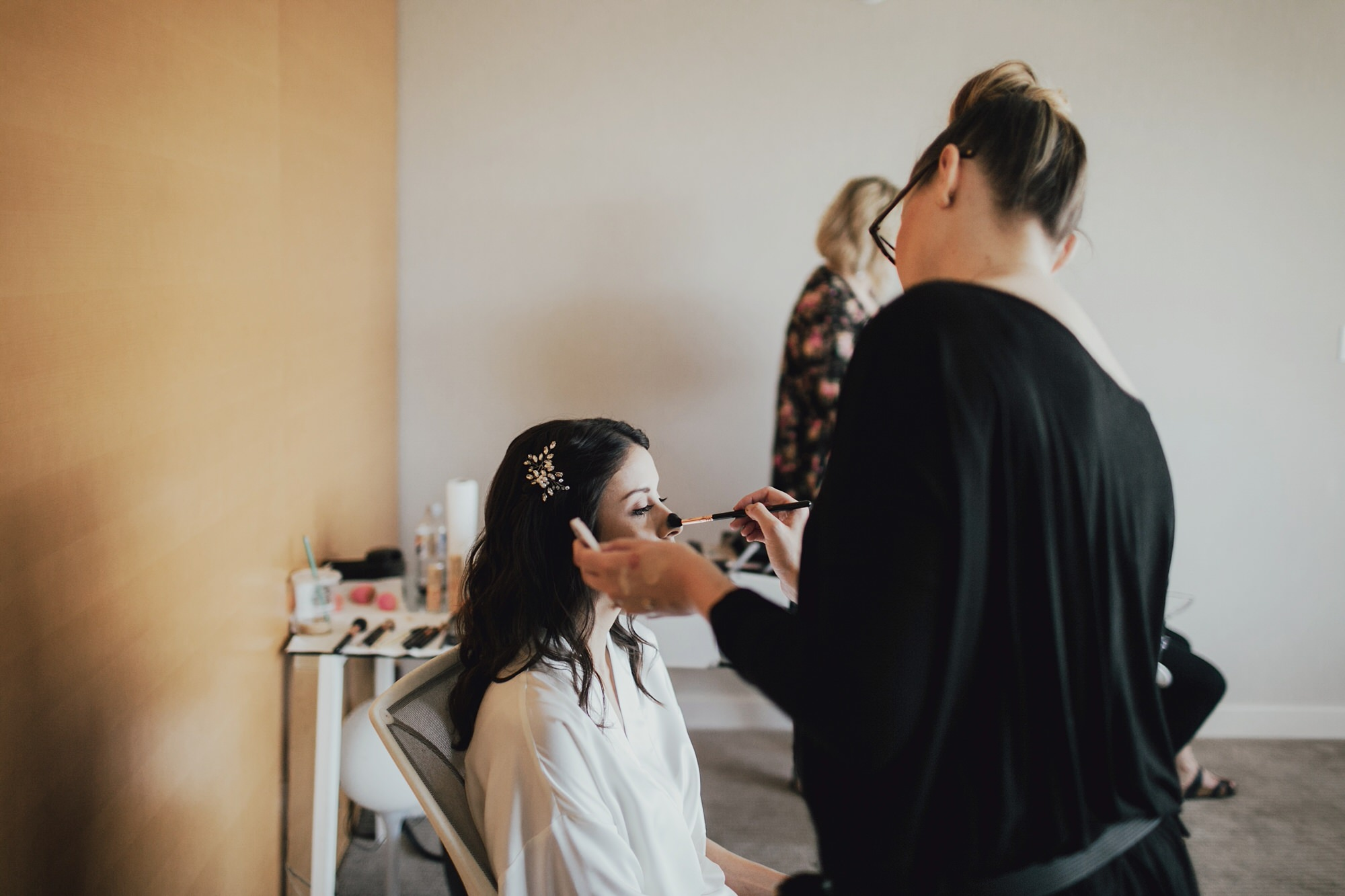 christine getting ready on her wedding day in long beach