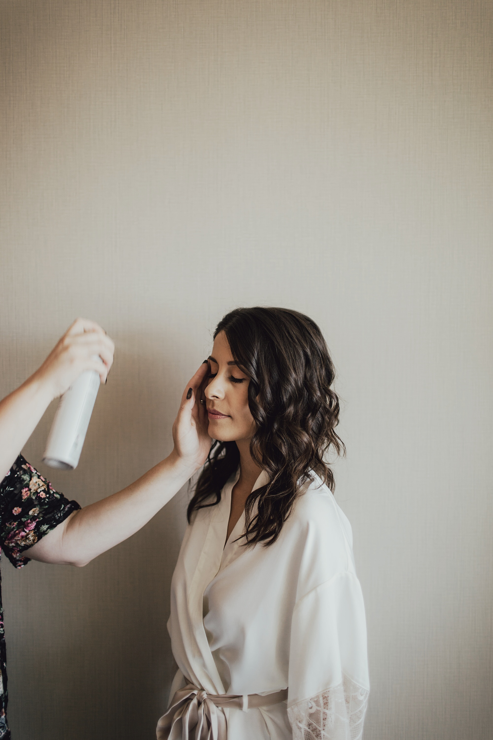 christine getting her hair done on her wedding day
