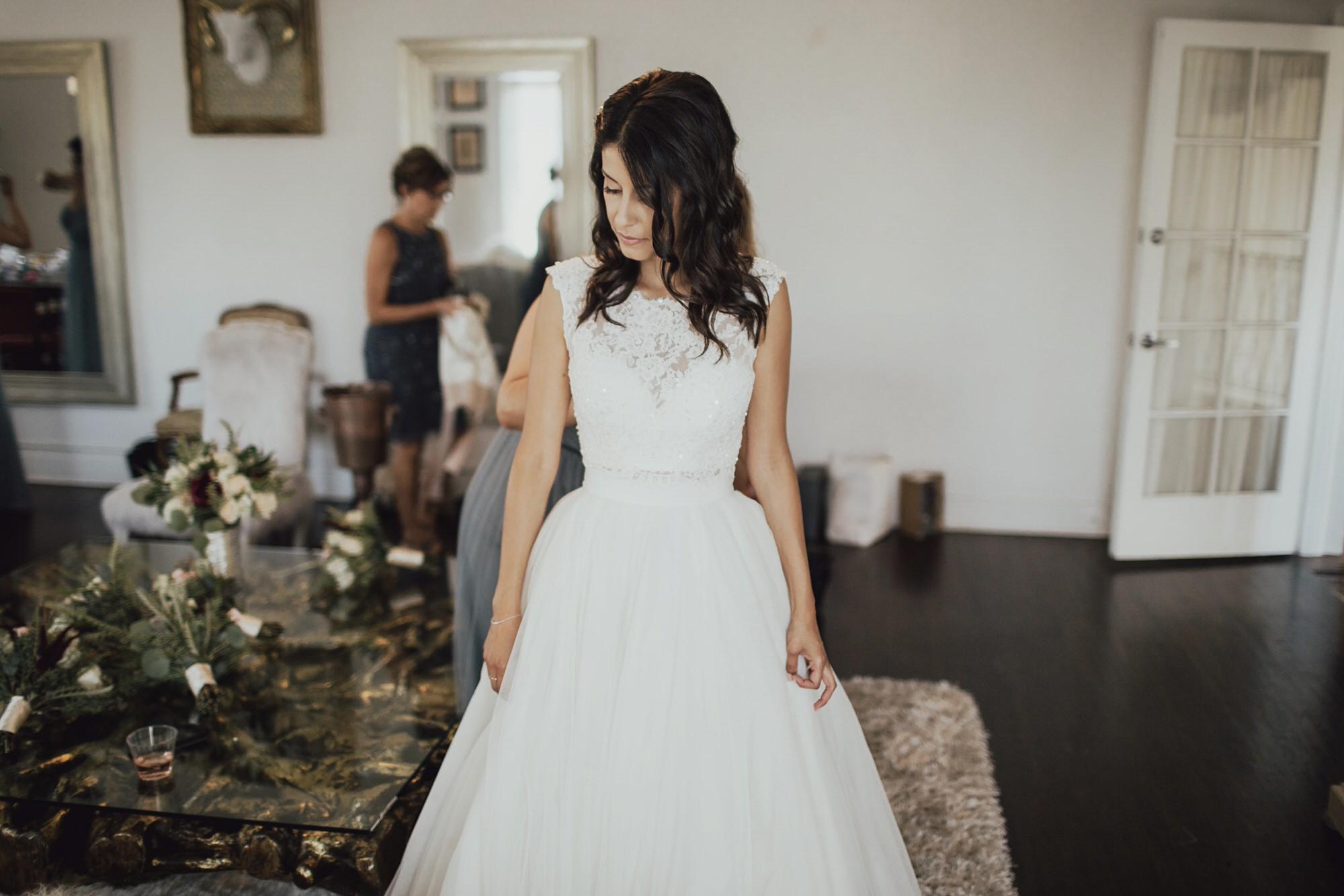 christine getting in her wedding dress