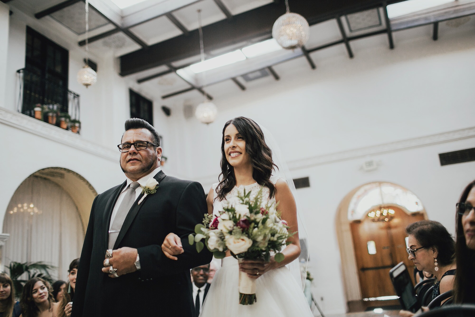 christine walking down the aisle with her dad