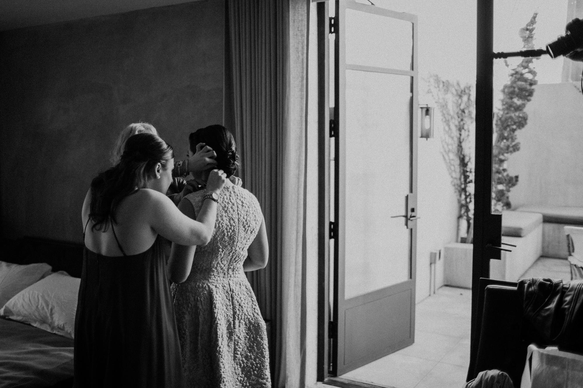 sasha putting on her wedding dress