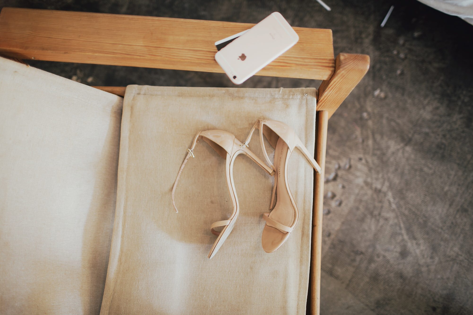 Wedding day shoes sitting on a chair at the Ace Hotel in Palm Springs