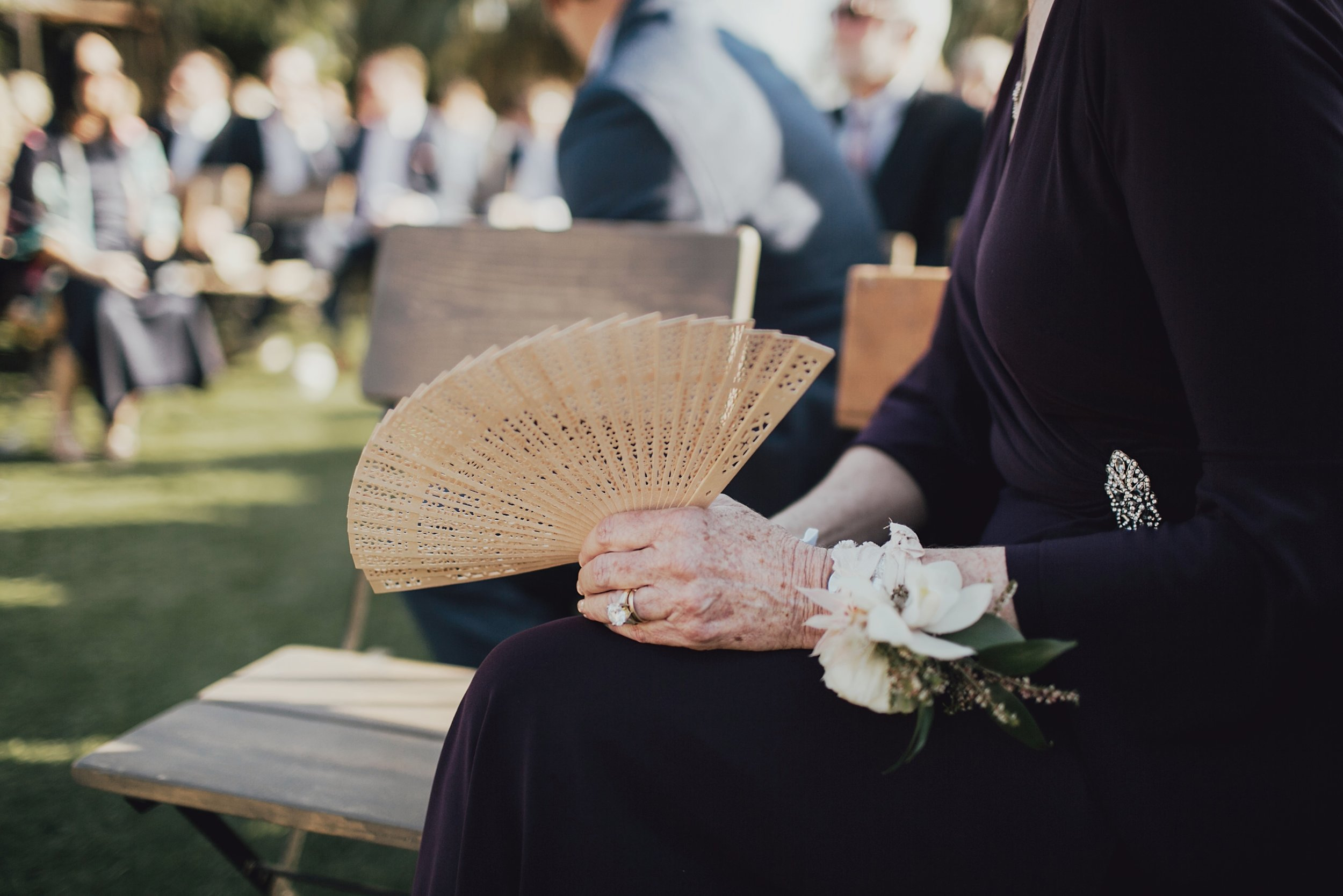 mother of the bride waiting for her daughter to walk down the aisle