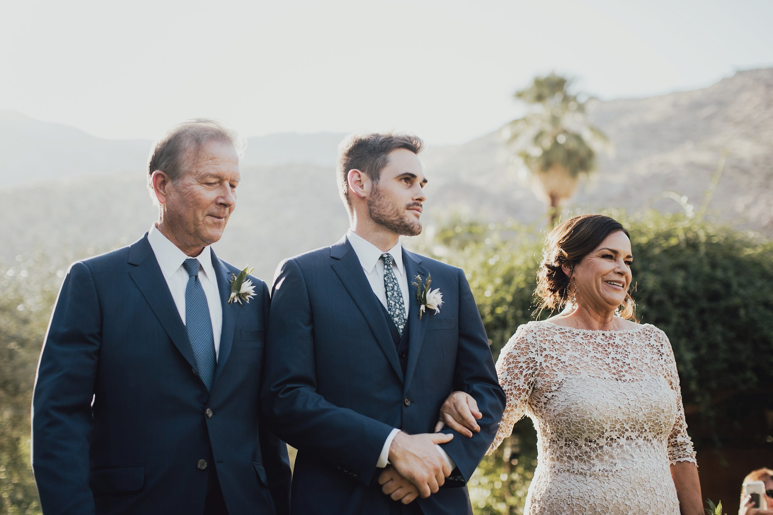 mark walking his parents down the aisle at the start of the ceremony