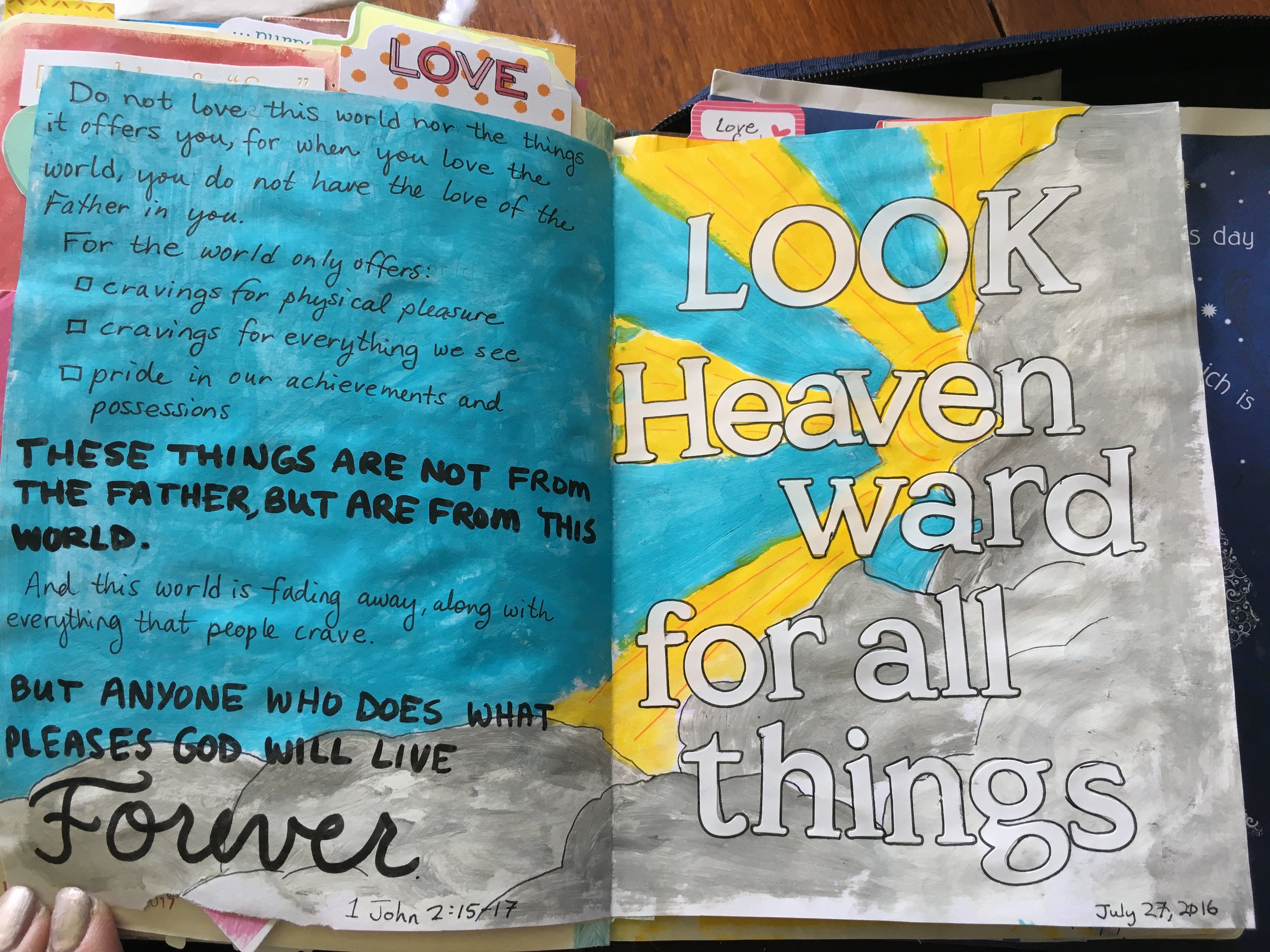 Sierra Burden 1 John 2:15-17   I loved how the paint and stickers worked well on the inside pages of this insert. The idea for me was to take the focus away from the worldly things and focus on the heavenly realm with clouds and a breath-taking sky/heaven. The verses talk about how the earthly desires are not what God wants us to focus on, but that He wants us to look heavenward for all things.