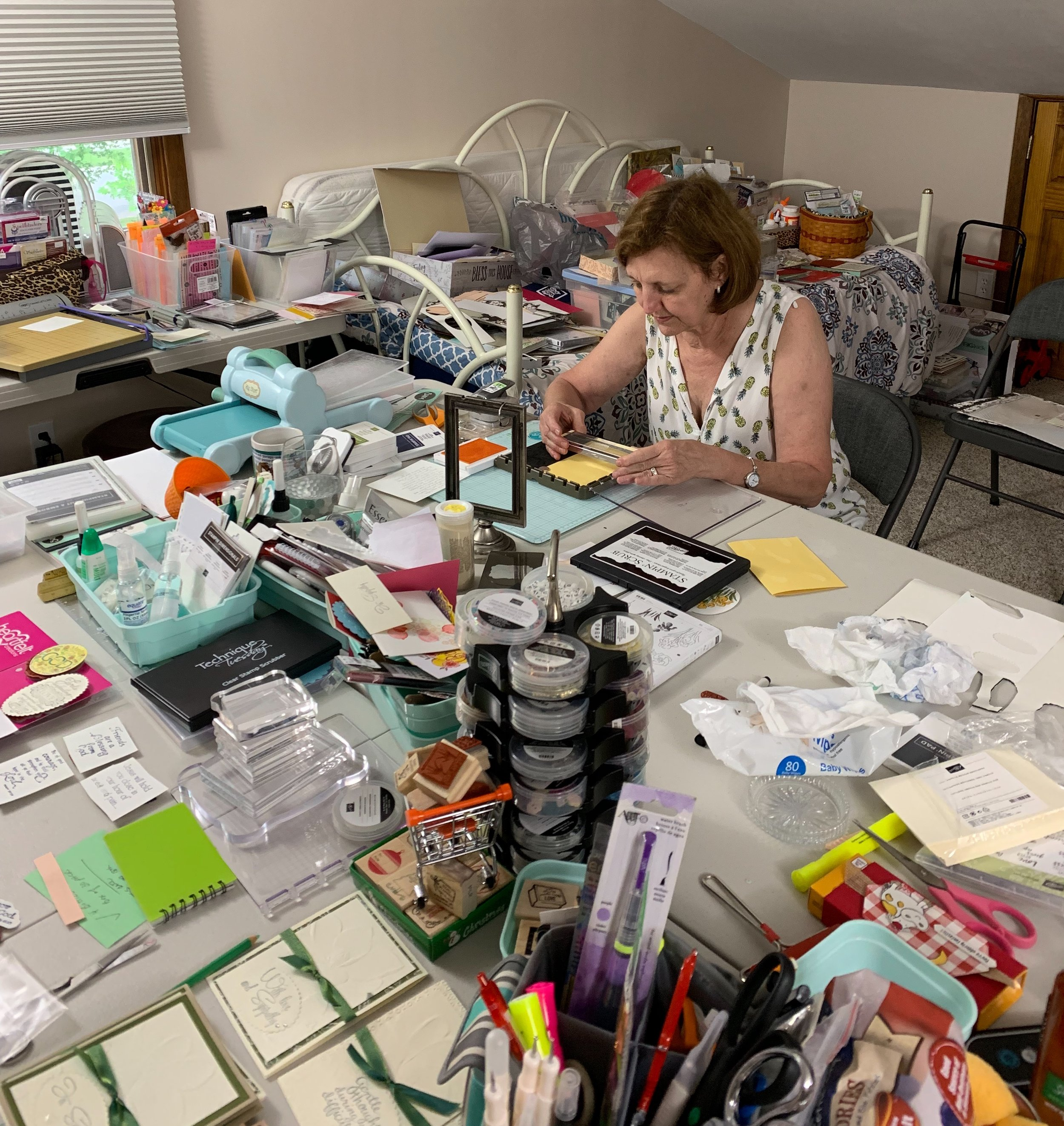 Here is Pamela in her studio- art room. She is very excited about a renewed enthusiasm about her card ministry. She prays over each card and the person receiving the card. She feels that card-making is a lost art and is especially blessed by the practice of creating prayer cards.