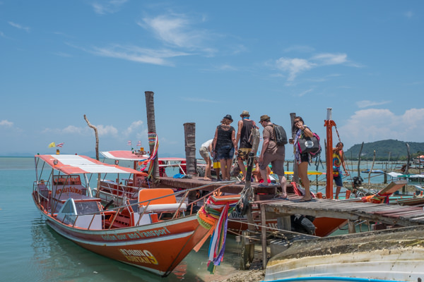 One of these colorful motor boats took us across