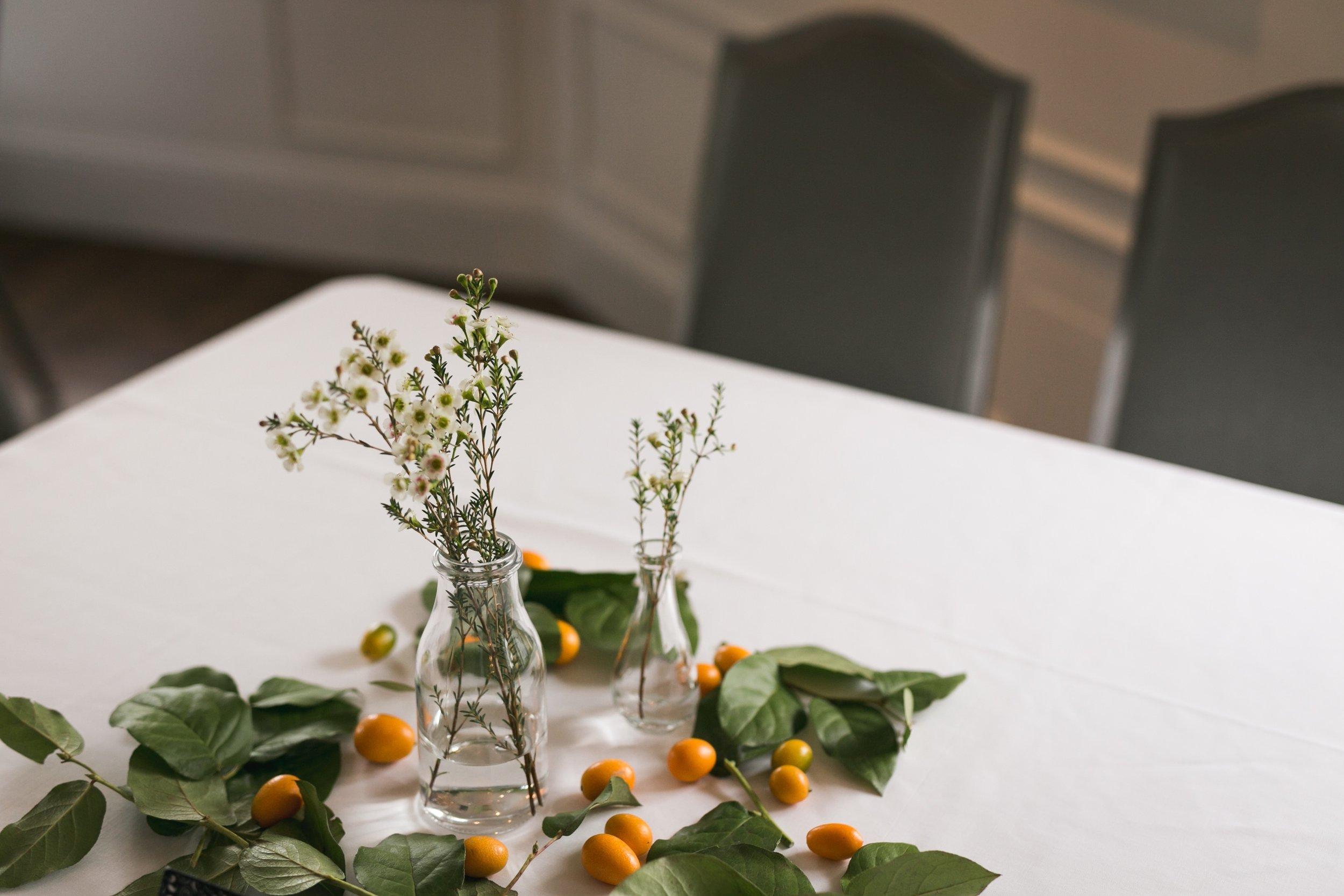 kumquats and wax flower table #lrqcfloral #kumquats