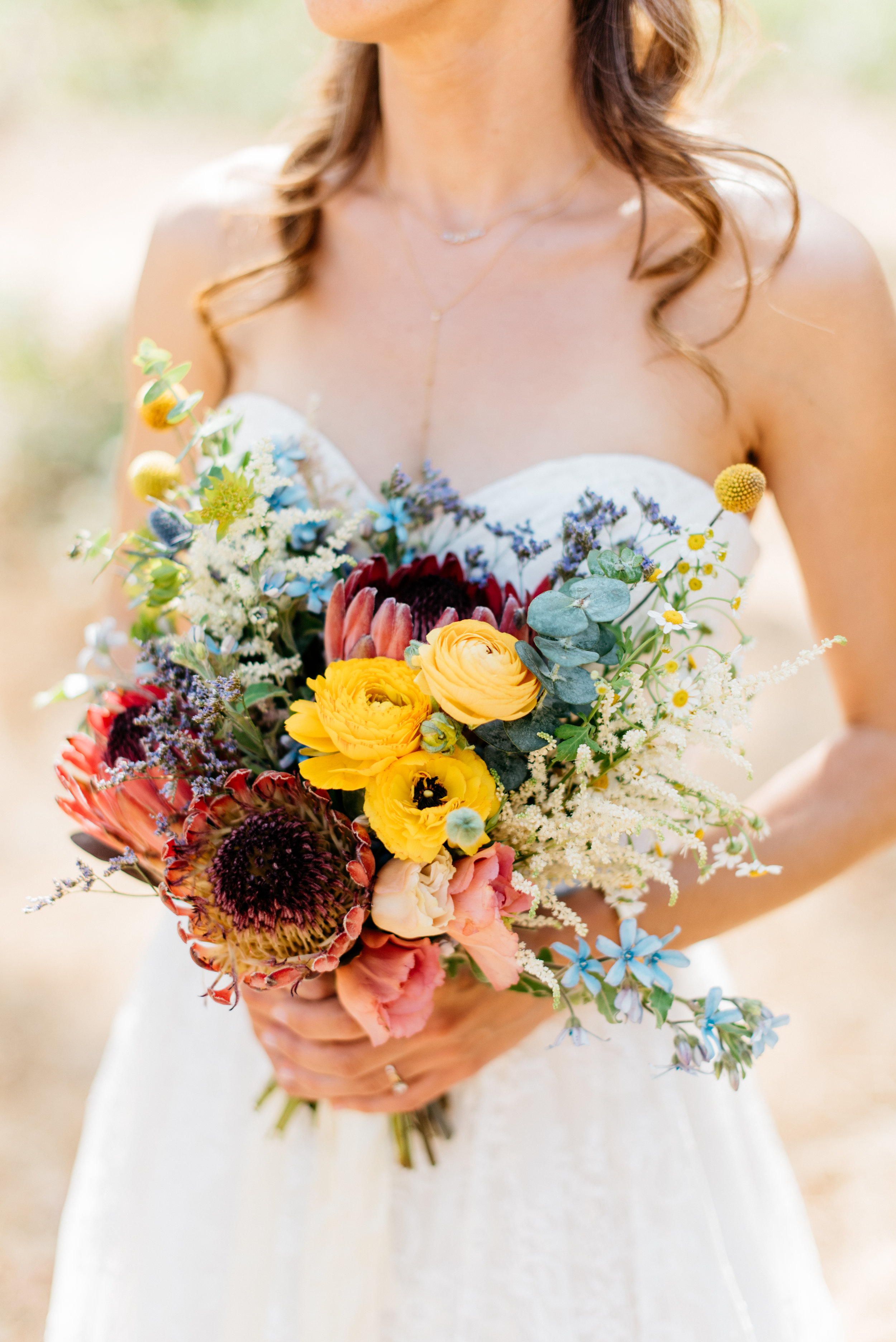 bright wildflower and protea bouquet #lrqcfloral