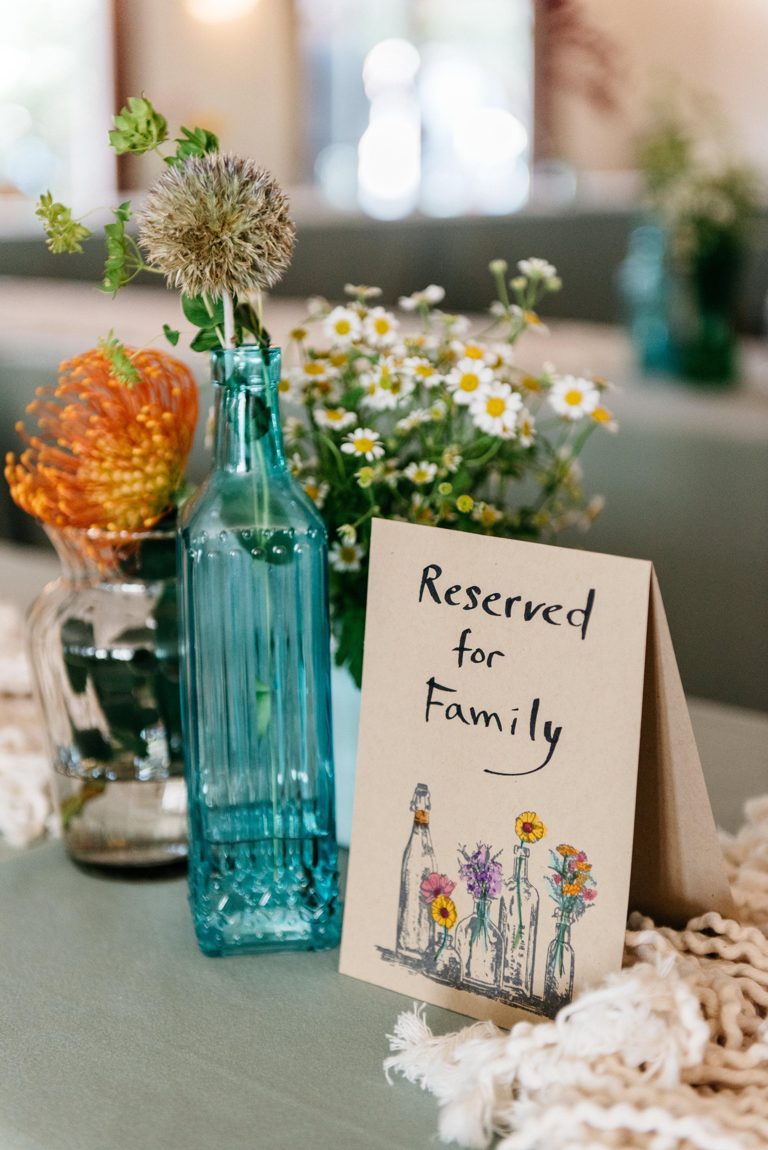 bright florals in bottles #lrqcfloral #bohowedding
