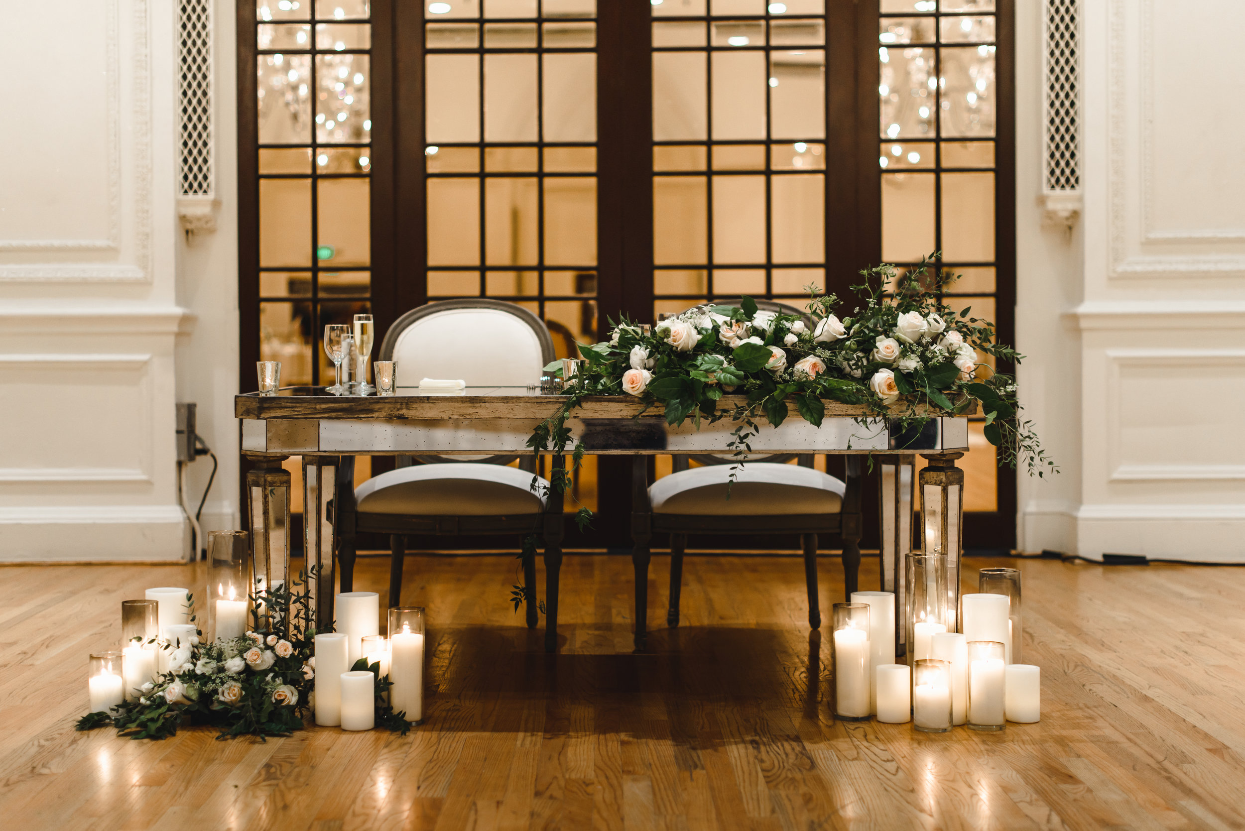 blush and white sweetheart table flowers with candles #lrqcfloral #sweetheart .jpg