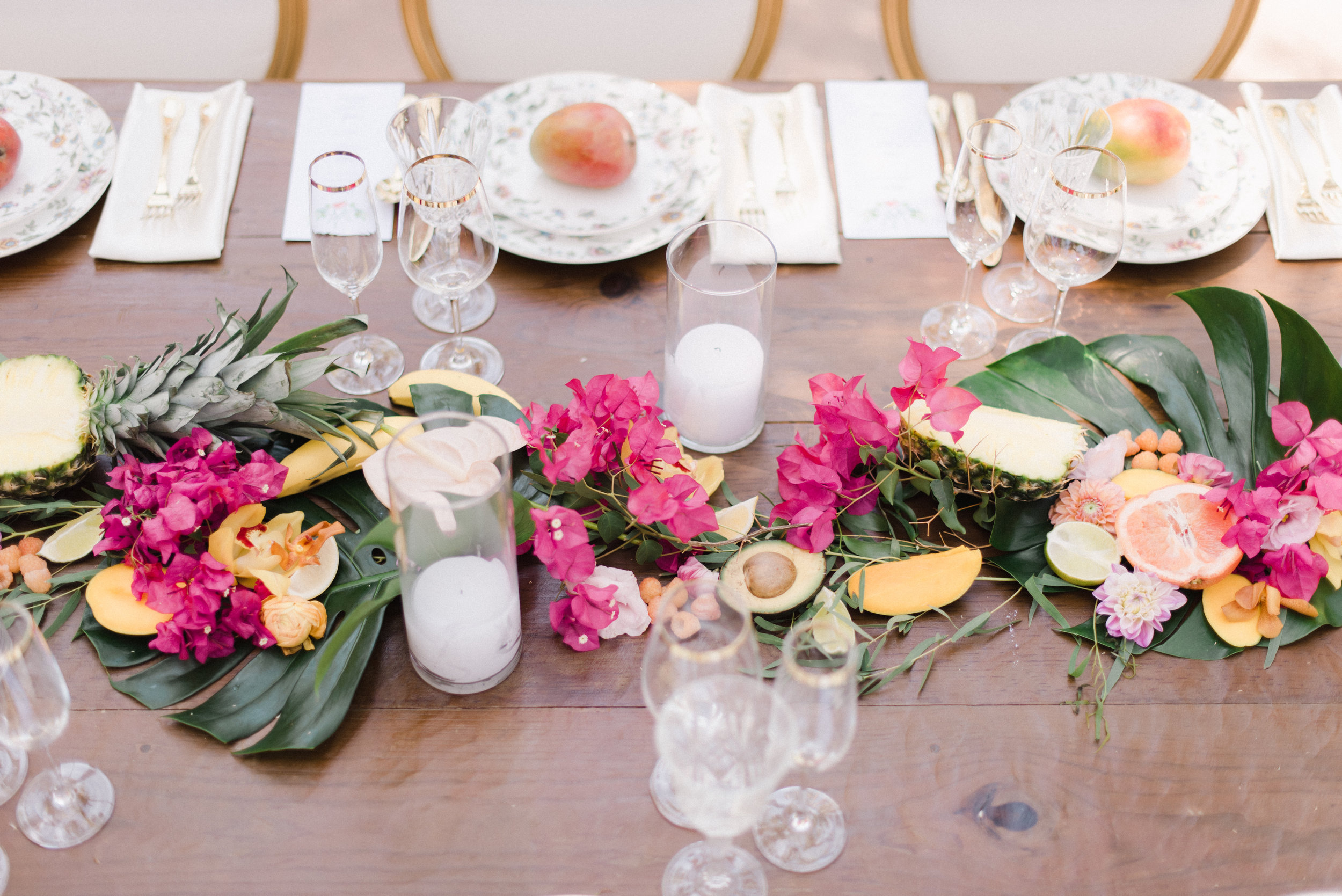 Avocado, tropical leaves, bougainvillea flowers, pineapple wedding table.jpg