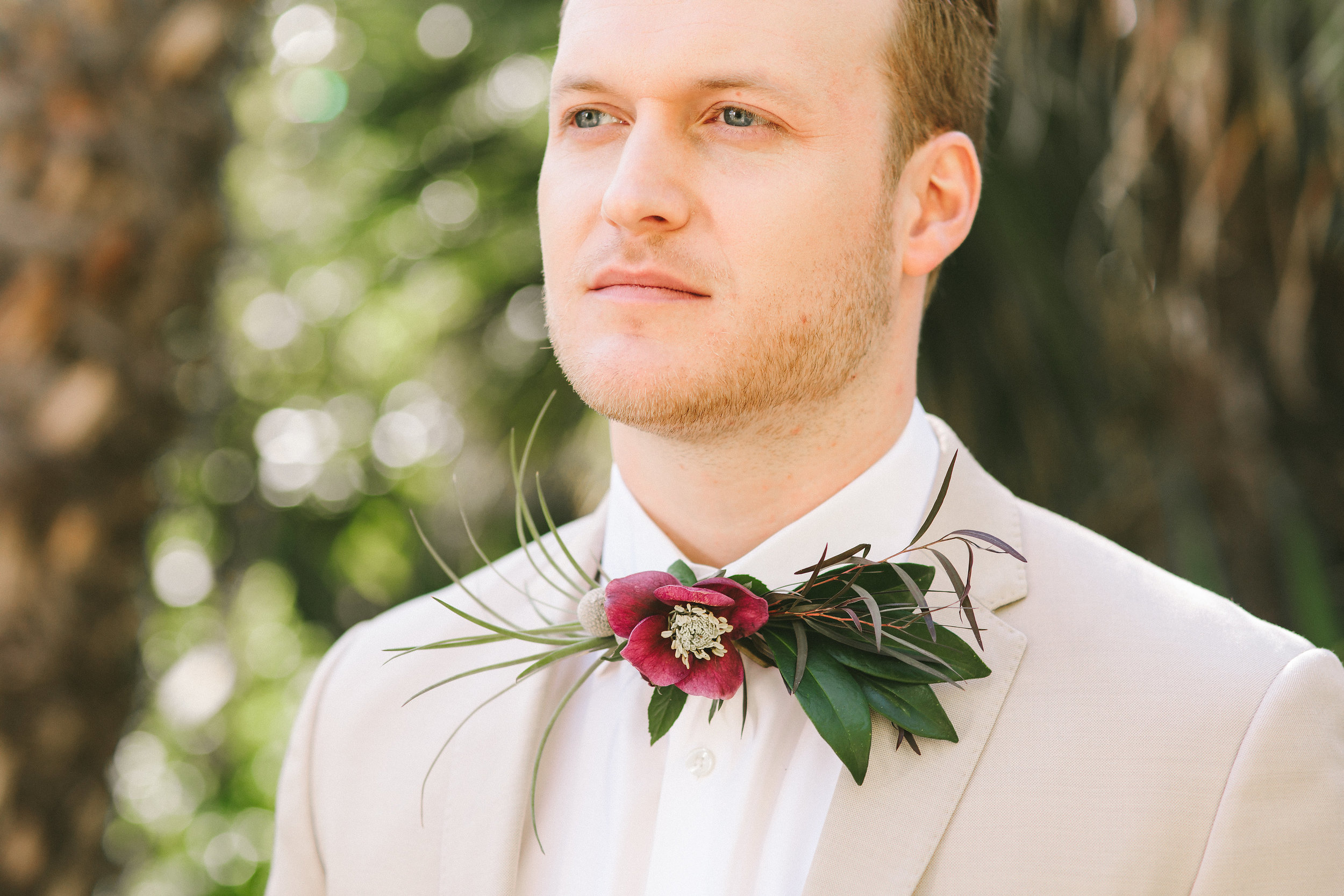 fresh floral bow tie made of purple flowers and airplants.jpg