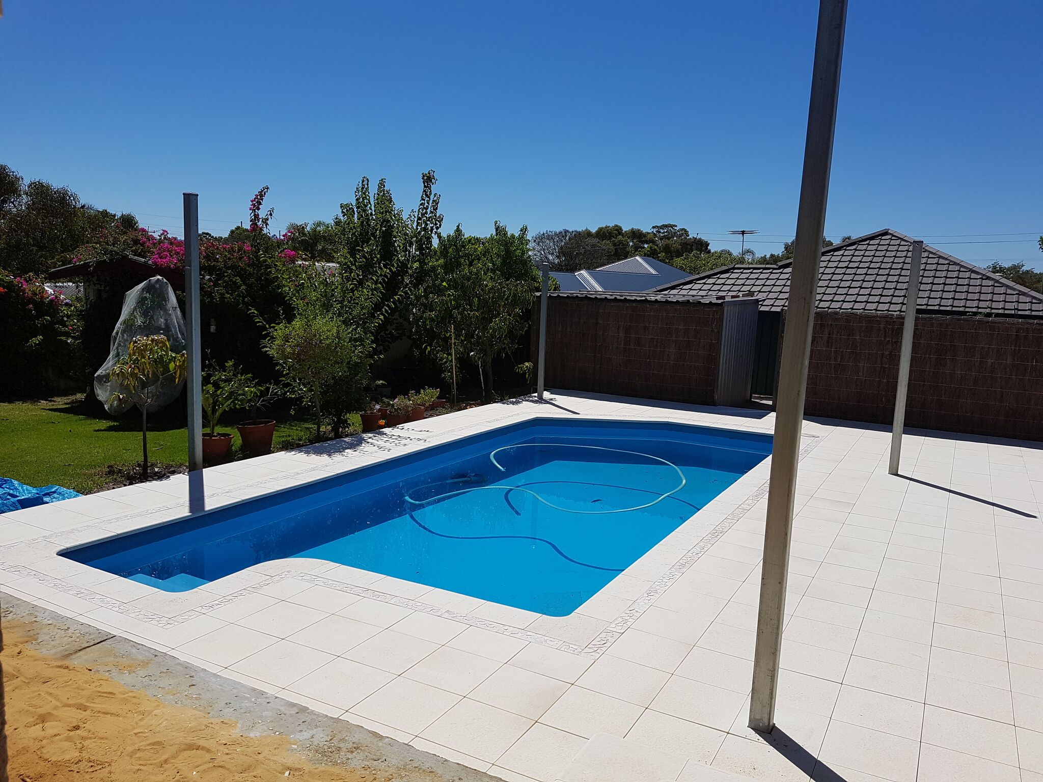After:  New paving resulted in a fresh open look to the pool area.  Read our Review.