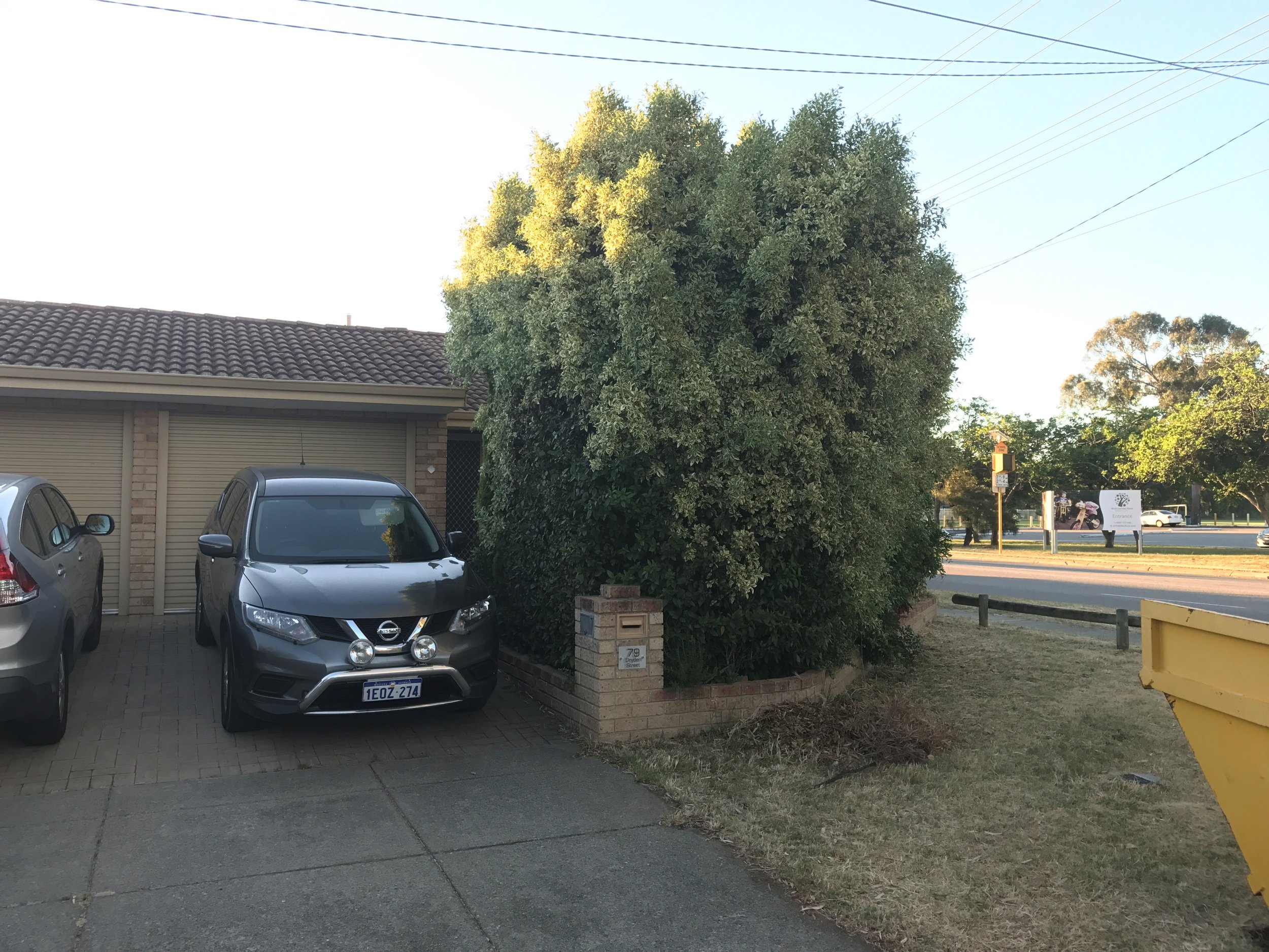 Before:  This home needed a more substantial frontage, and more privacy from the road.