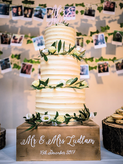 buttercream ruffle wedding cake with fresh flowers.png