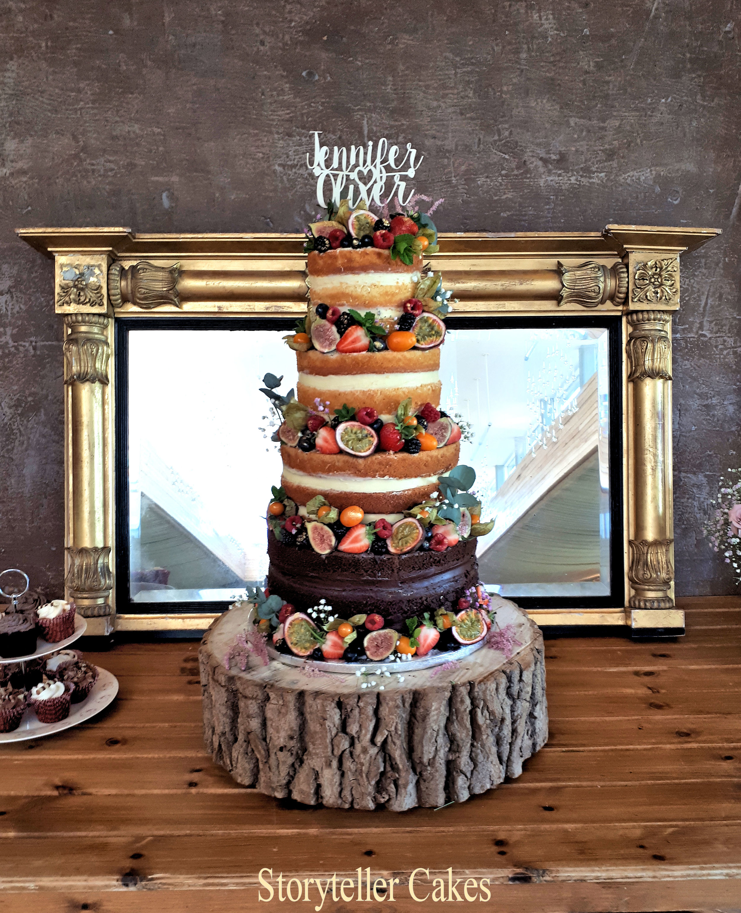 beautiful naked wedding cake with fruit.jpg