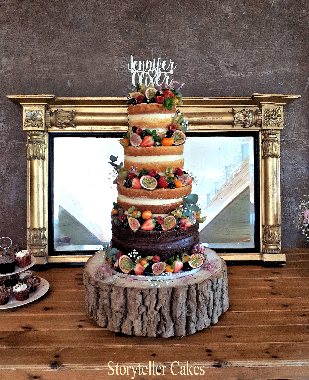 beautiful naked wedding cake with fruit.jpg
