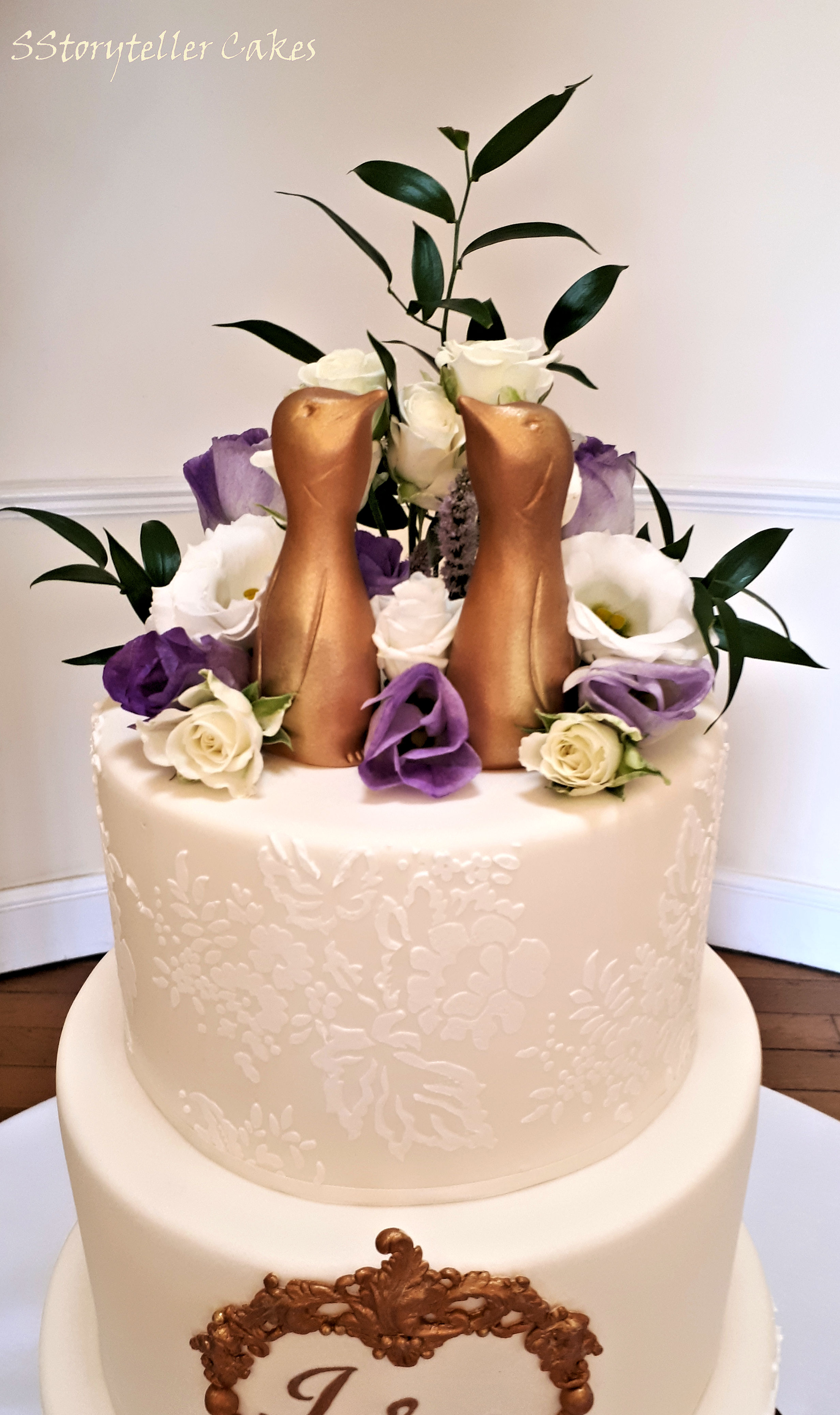 Lace cream and gold pengiun wedding cake.jpg