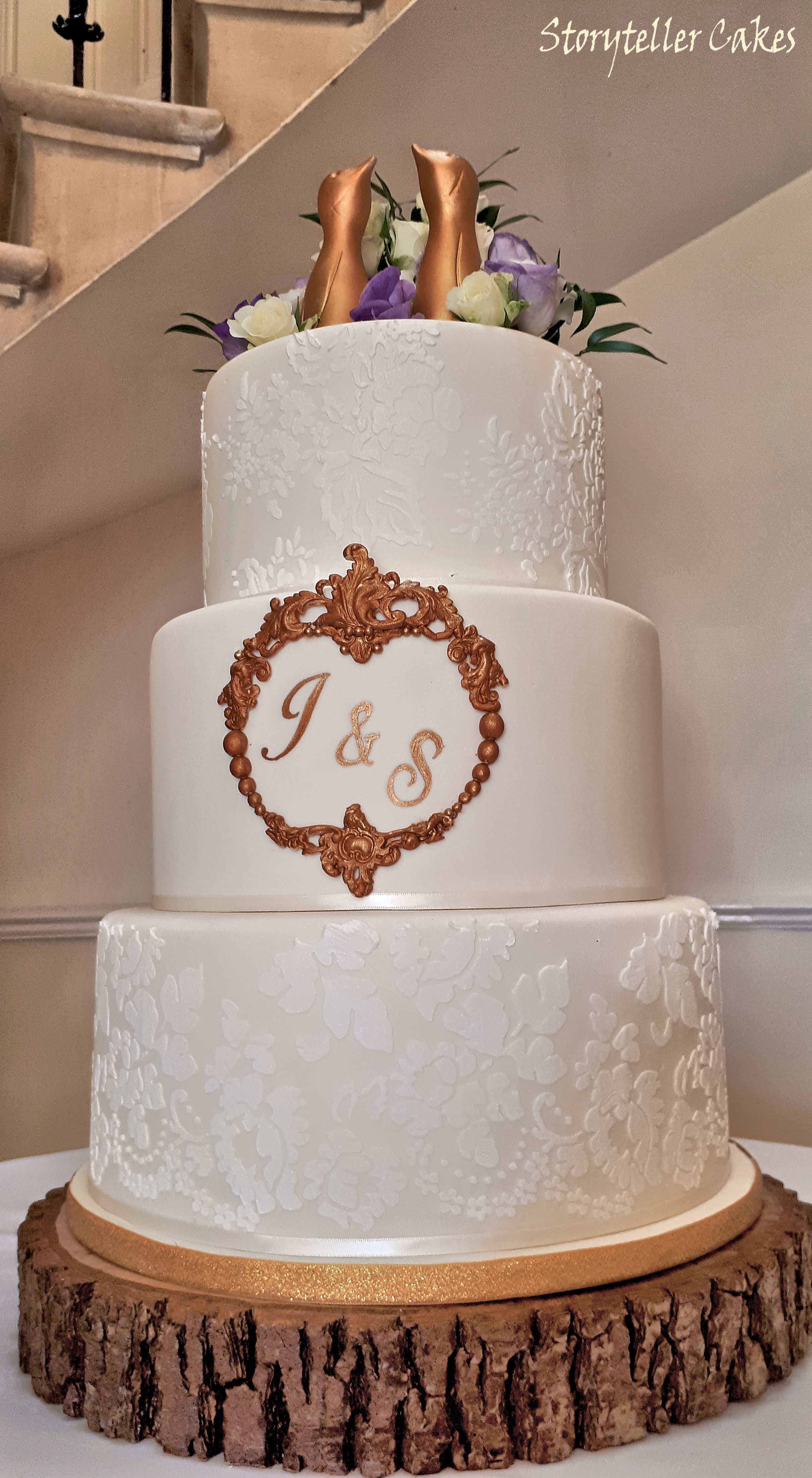 Lace cream and gold pengiun wedding cake 2.jpg