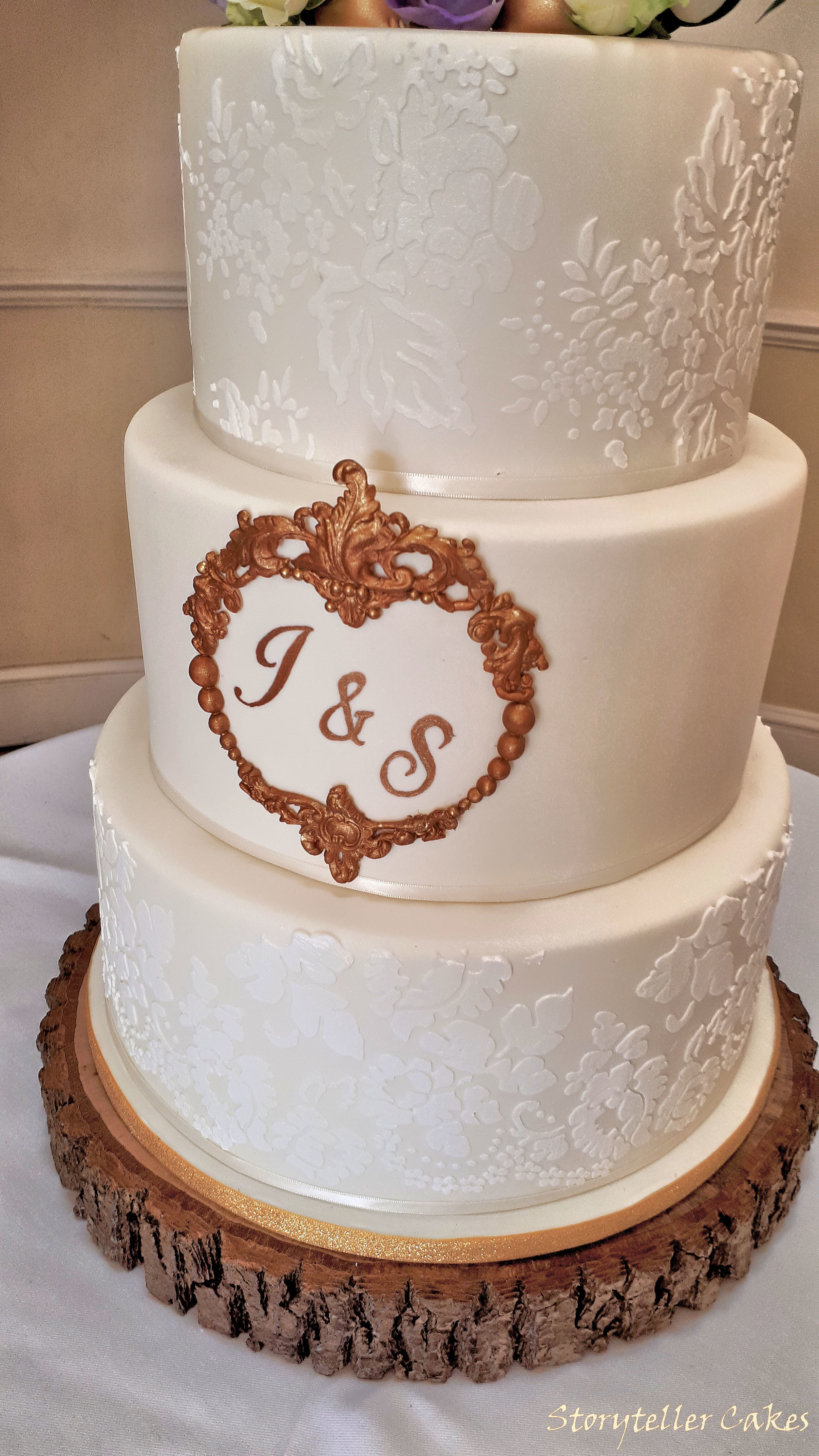 Lace cream and gold pengiun wedding cake3.jpg