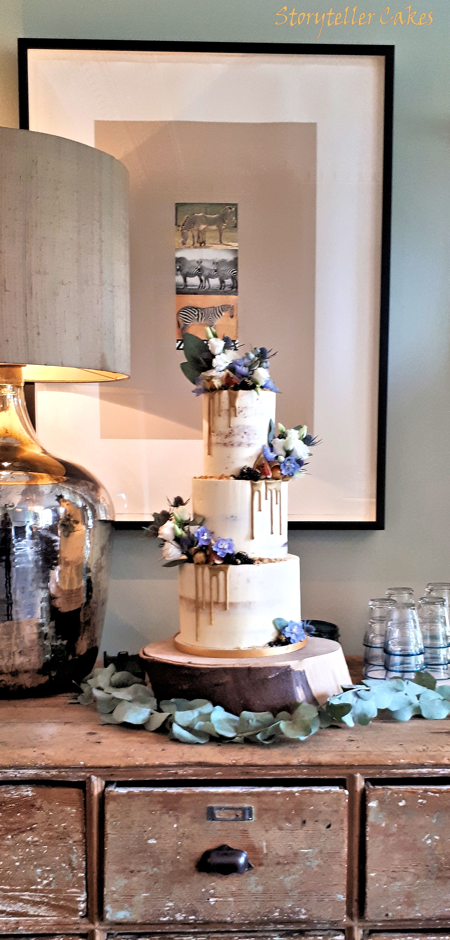 Semi Naked Wedding Cake with Blue and gold thisltes and fruit3.jpg