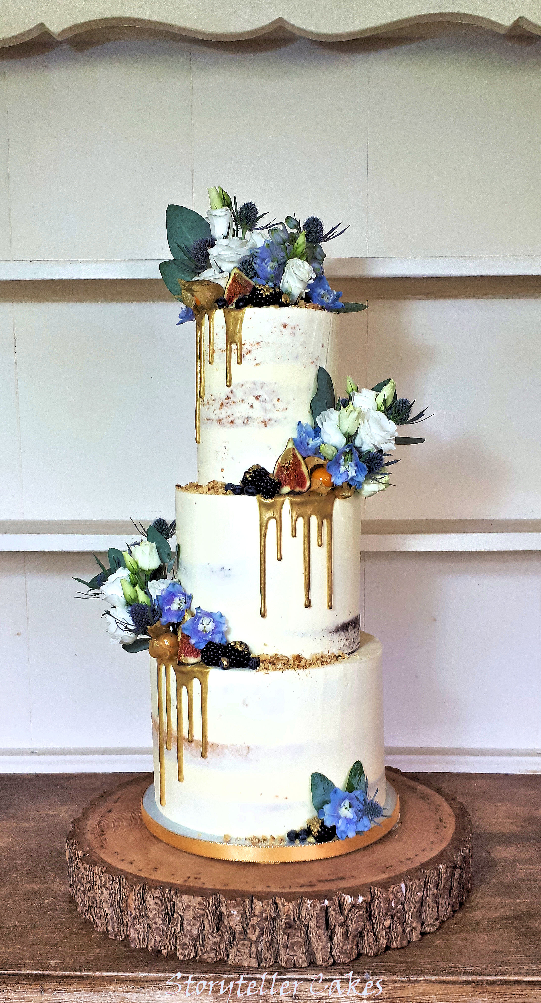 Semi Naked Wedding Cake with Blue and gold thisltes and fruit4.jpg