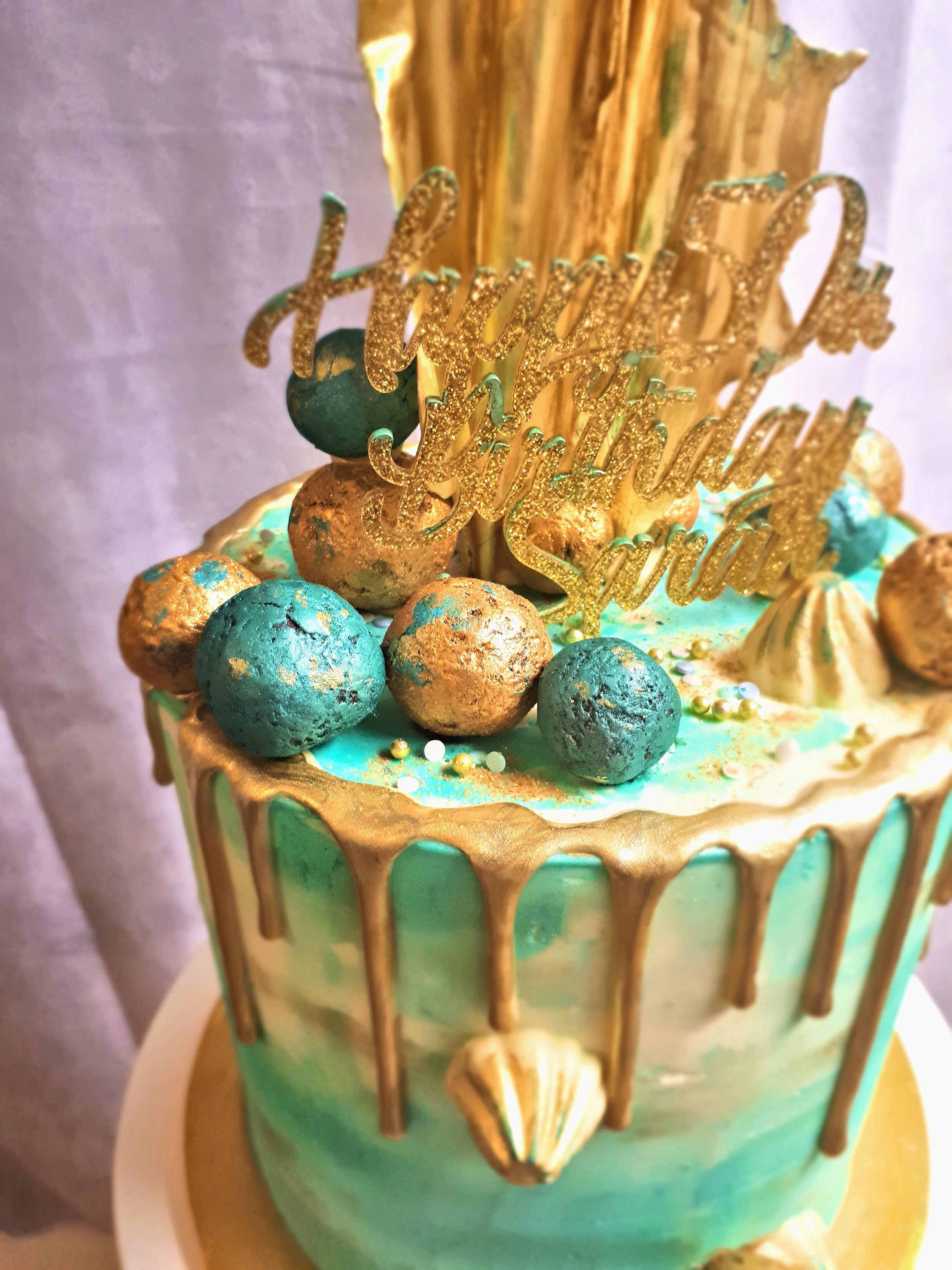 blue and gold buttercream drip cake 2.jpg