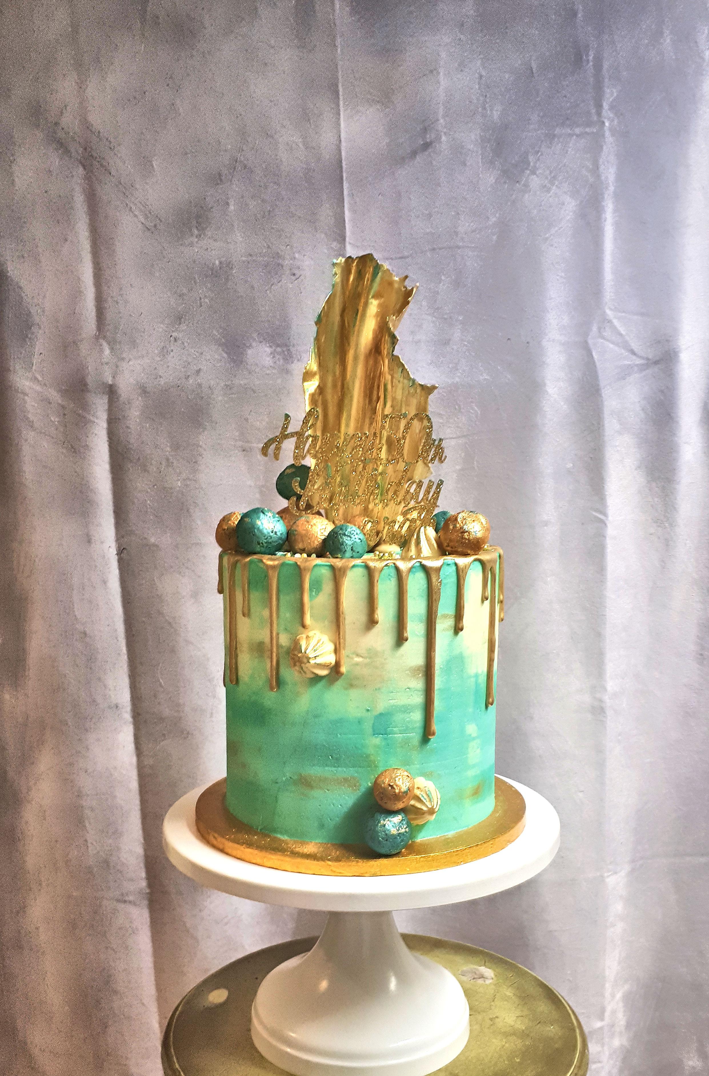 blue and gold buttercream drip cake.jpg