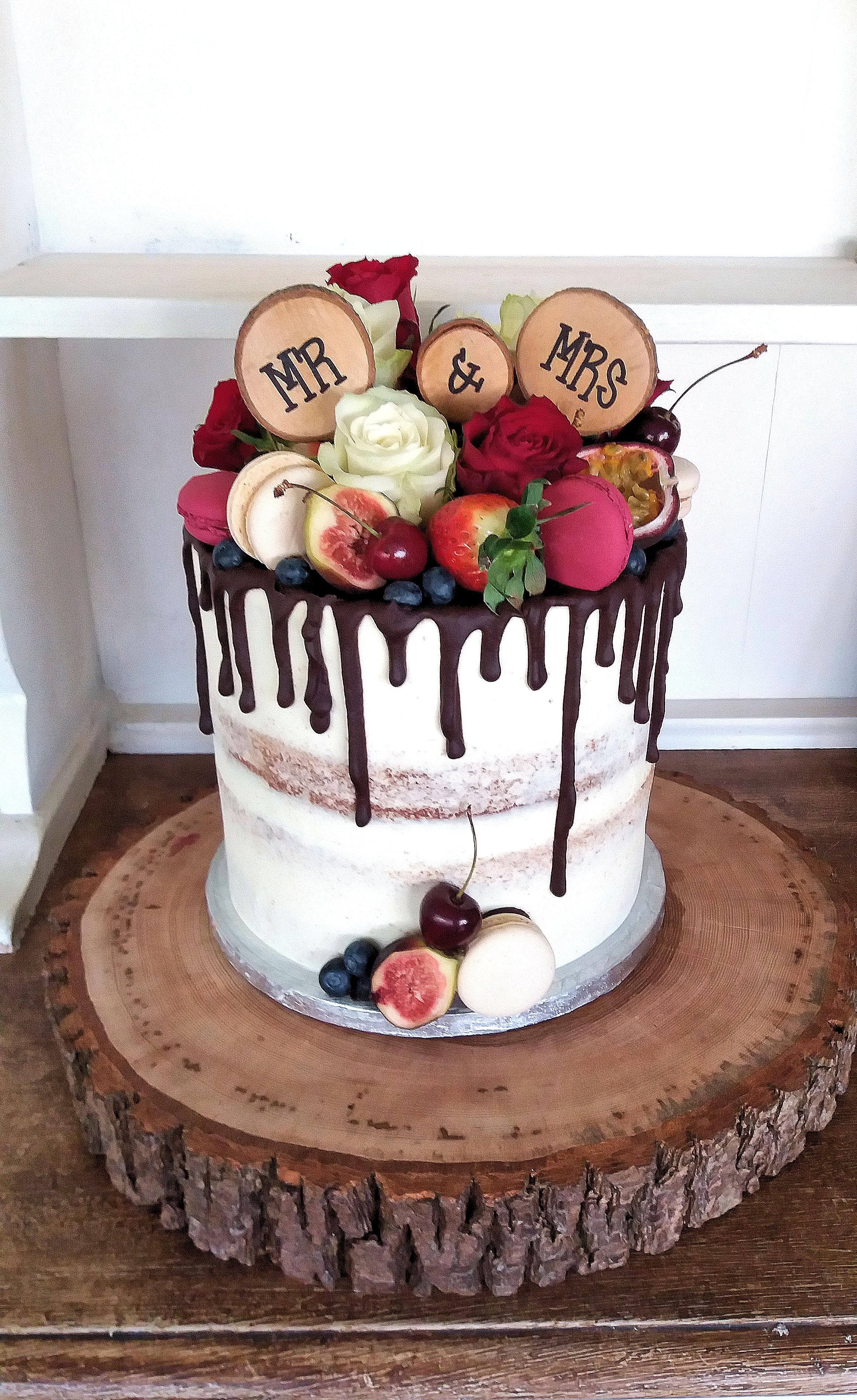 Semi Naked Wedding cake with fresh fruit and flowers.jpg