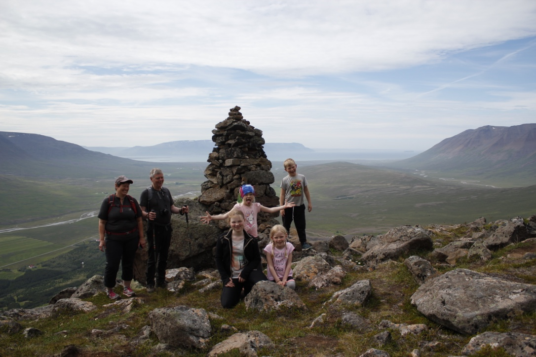 With Grandma and Grandpa at the cairn in Gvendarskál
