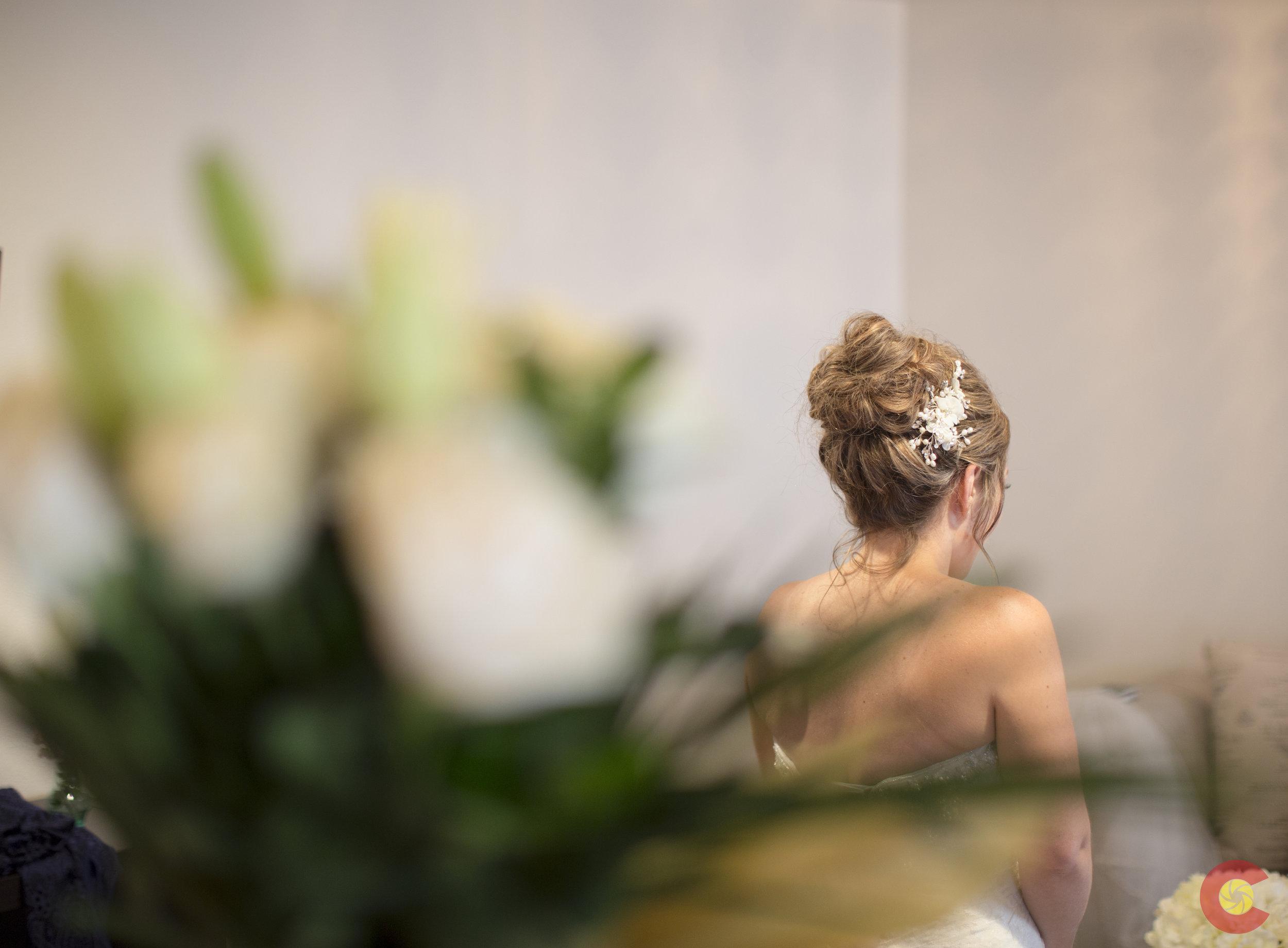 Bride Silent Moment through flowers.jpg