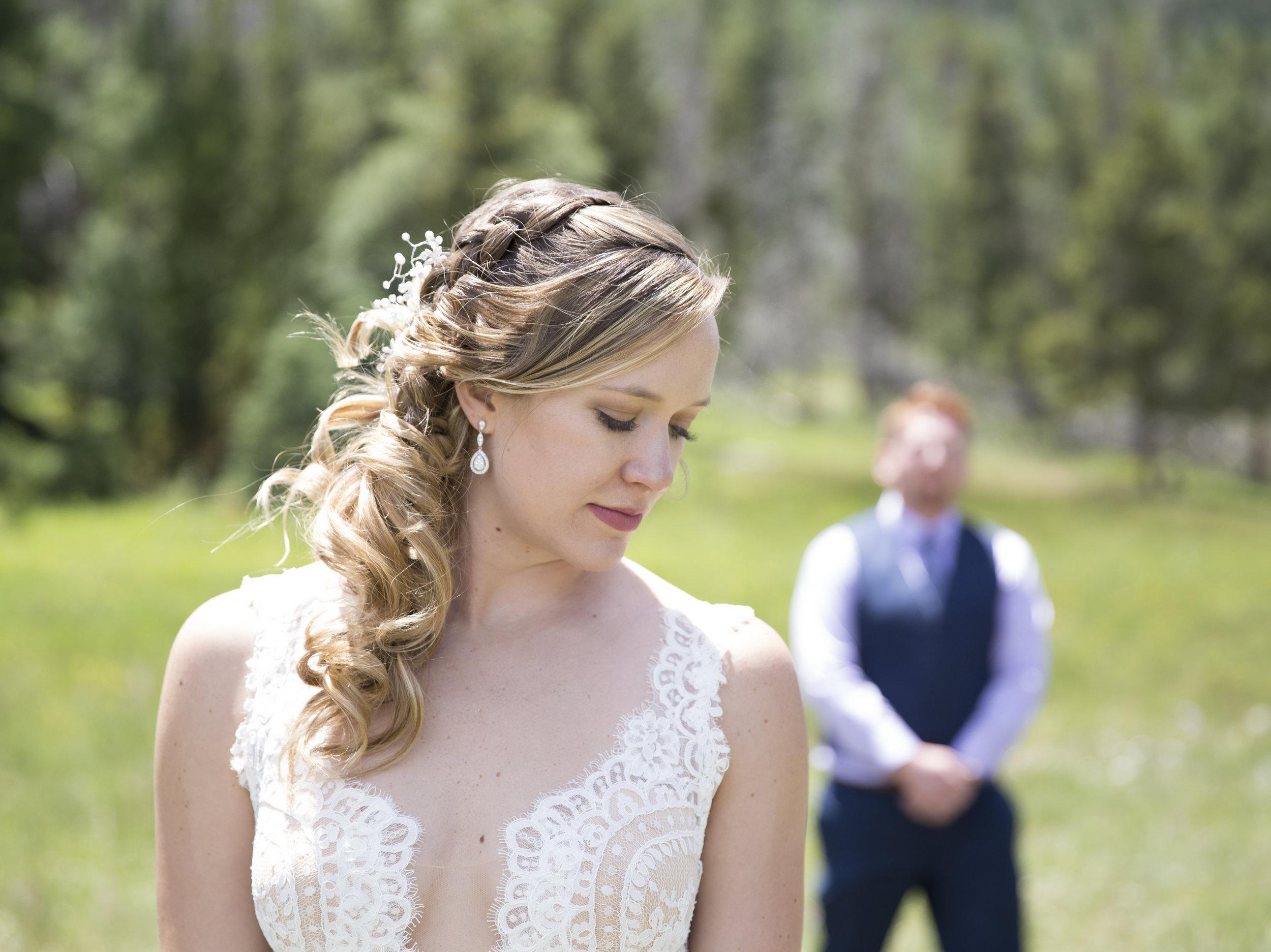 Bride w Chance blurred behind her.jpg