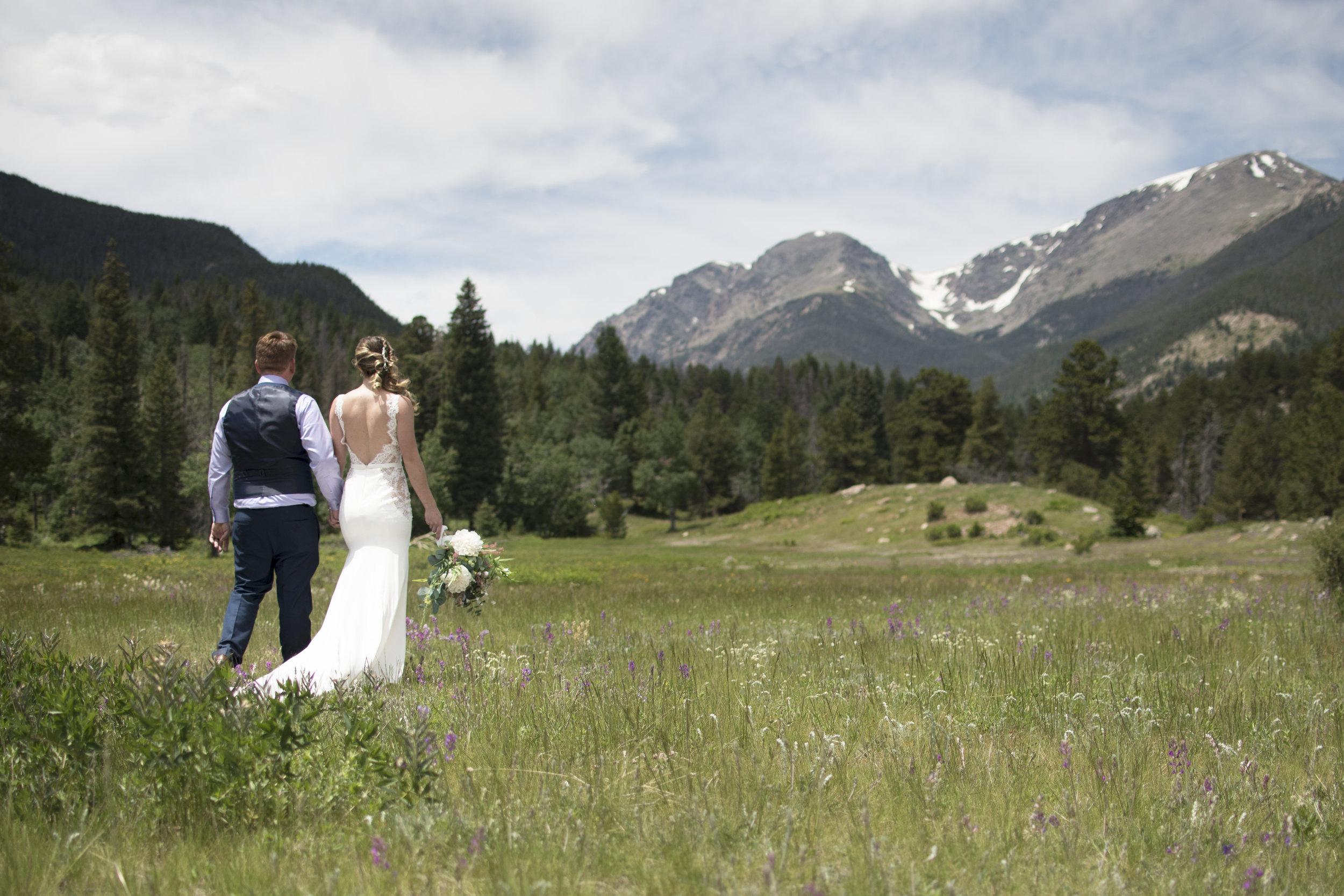 Couple walking in the field wide.jpg