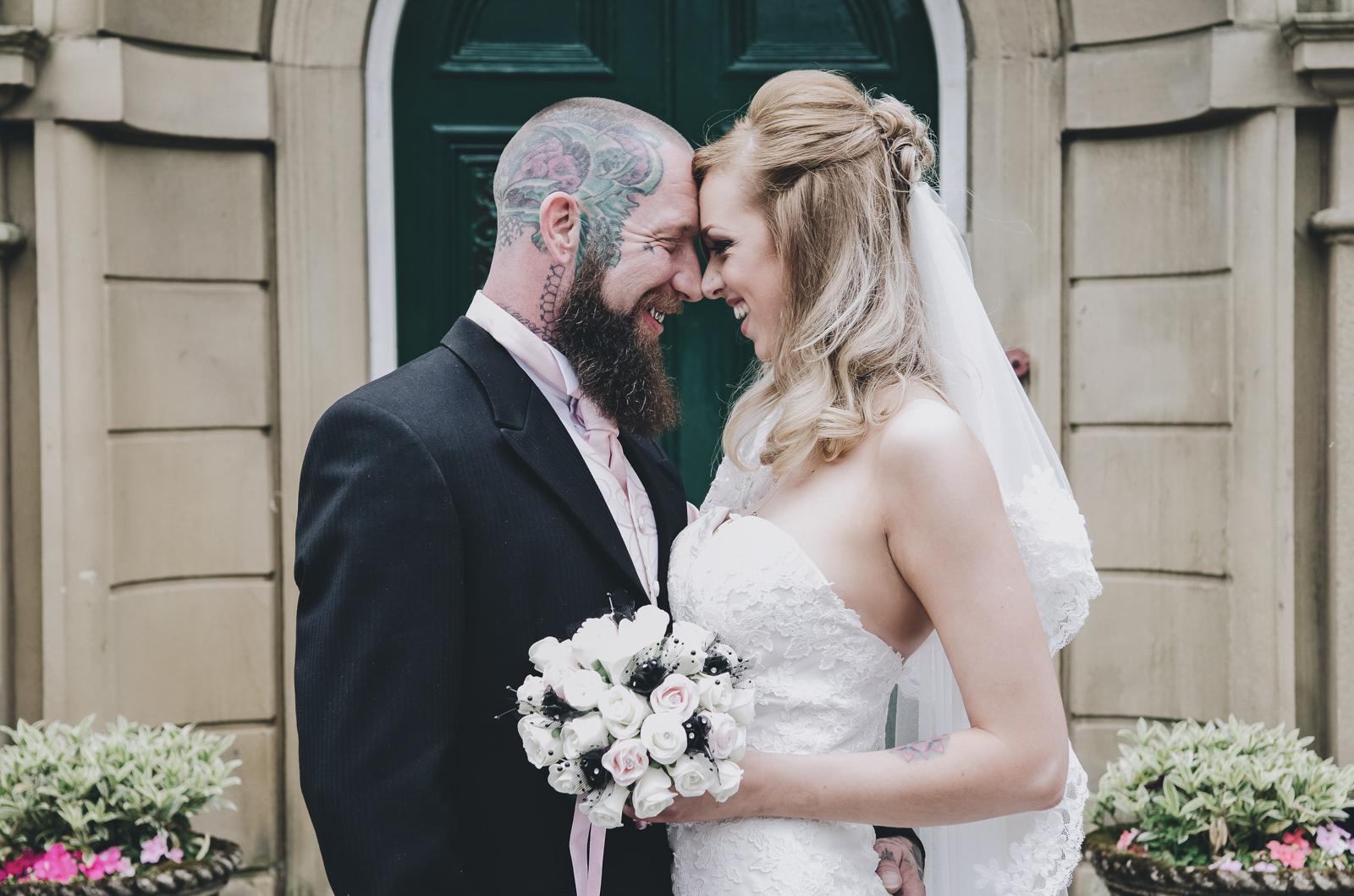 Alternative-North-West-Manchester-Wedding-Photography-Astley-bank-Wedding-skull-cake-tattooed-groom-18.jpg