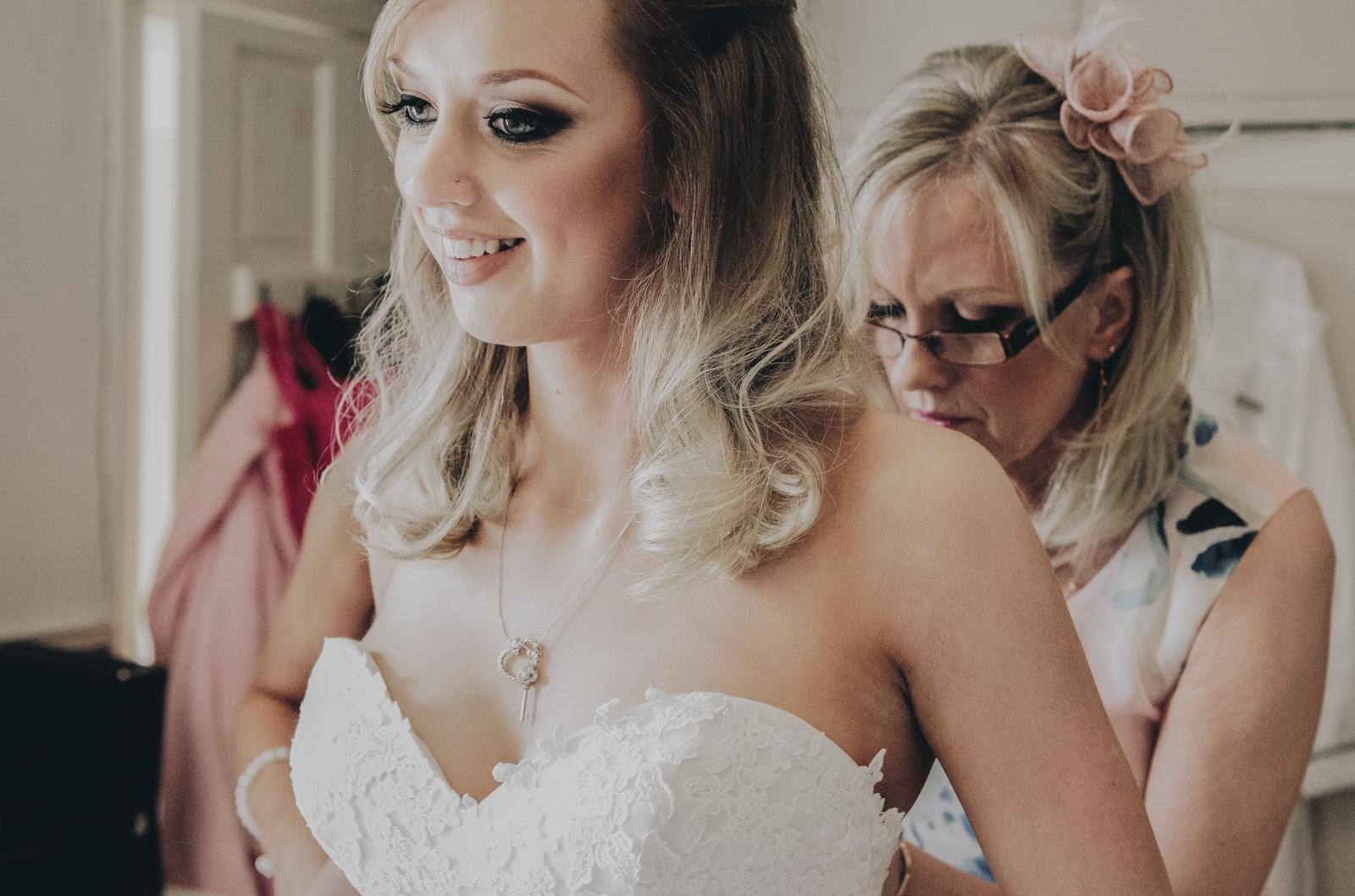 Alternative-North-West-Manchester-Wedding-Photography-Astley-bank-Wedding-skull-cake-tattooed-groom-4.jpg